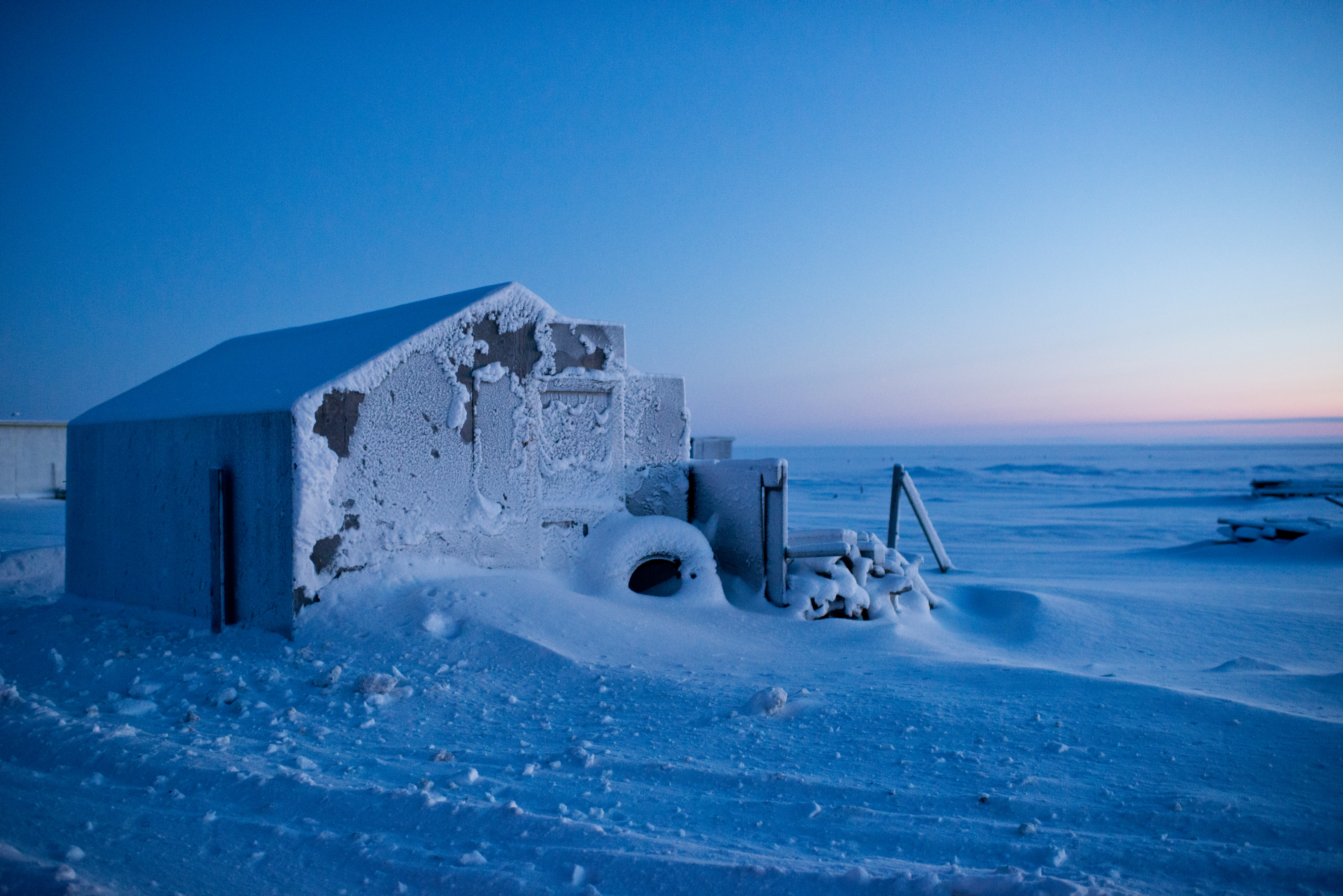 A cabin at a summer camps outside of Utqiaġvik is drifted with snow and coated in frost on Tuesday, December 13, 2016. Voters approved changing the name of the city of Barrow to Utqiagvik in October, a change which went into effect on December 1. In Alaska's northernmost city, however, residents remain divided about whether they name should've changed at all, whether the process was hurried, and whether the Utqiagvik is even the proper Inupiaq place name. (Marc Lester / Alaska Dispatch News)