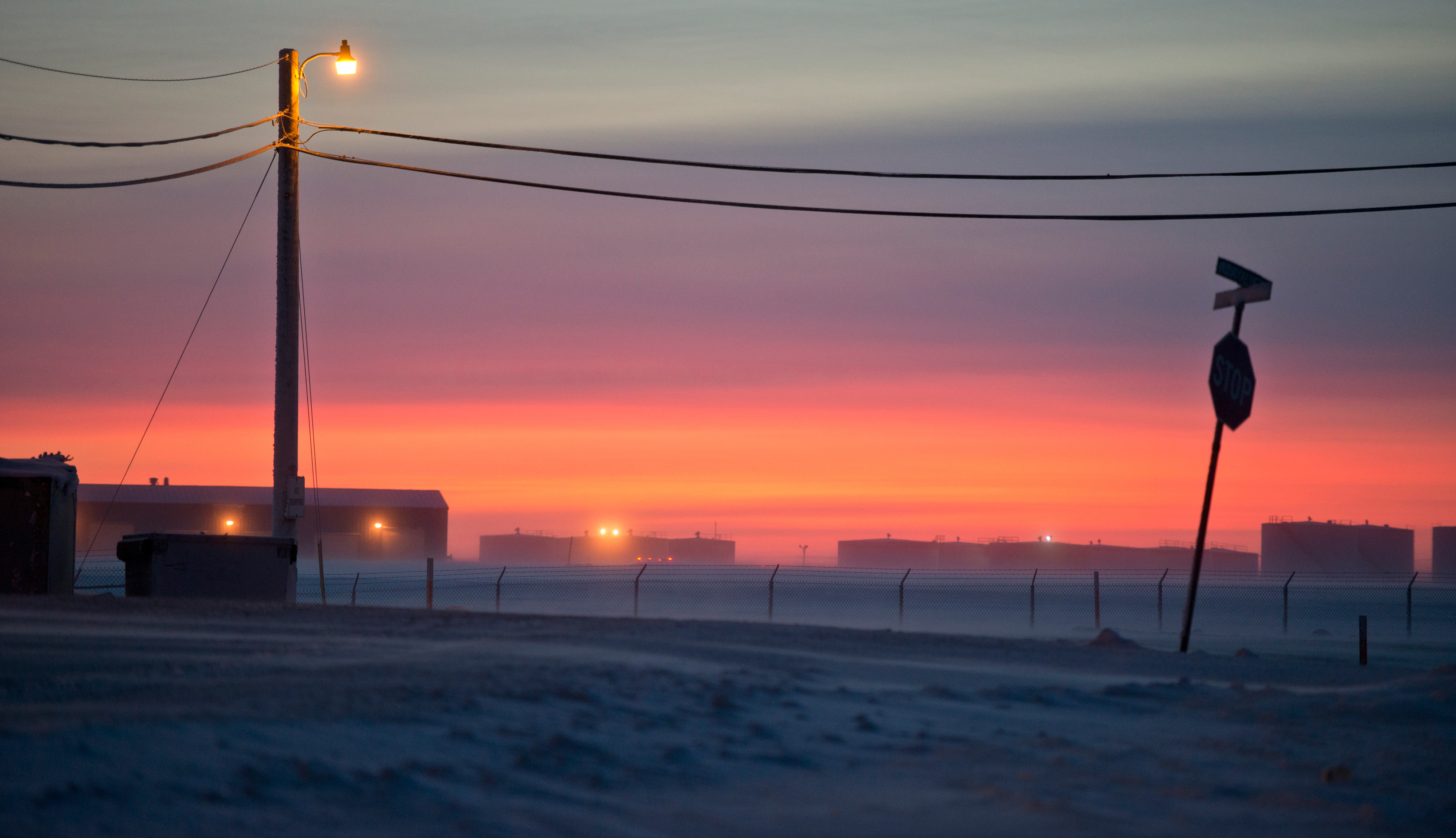 Midday light glows on the southern horizon as seen from Utqiaġvik, though the sun doesn't rise above it in December. Voters approved changing the name of the city of Barrow to Utqiagvik in October, a change which went into effect on December 1. In Alaska's northernmost city, however, residents remain divided about whether they name should've changed at all, whether the process was hurried, and whether the Utqiagvik is even the proper Inupiaq place name. Photographed on Wednesday, December 14, 2016. (Marc Lester / Alaska Dispatch News)