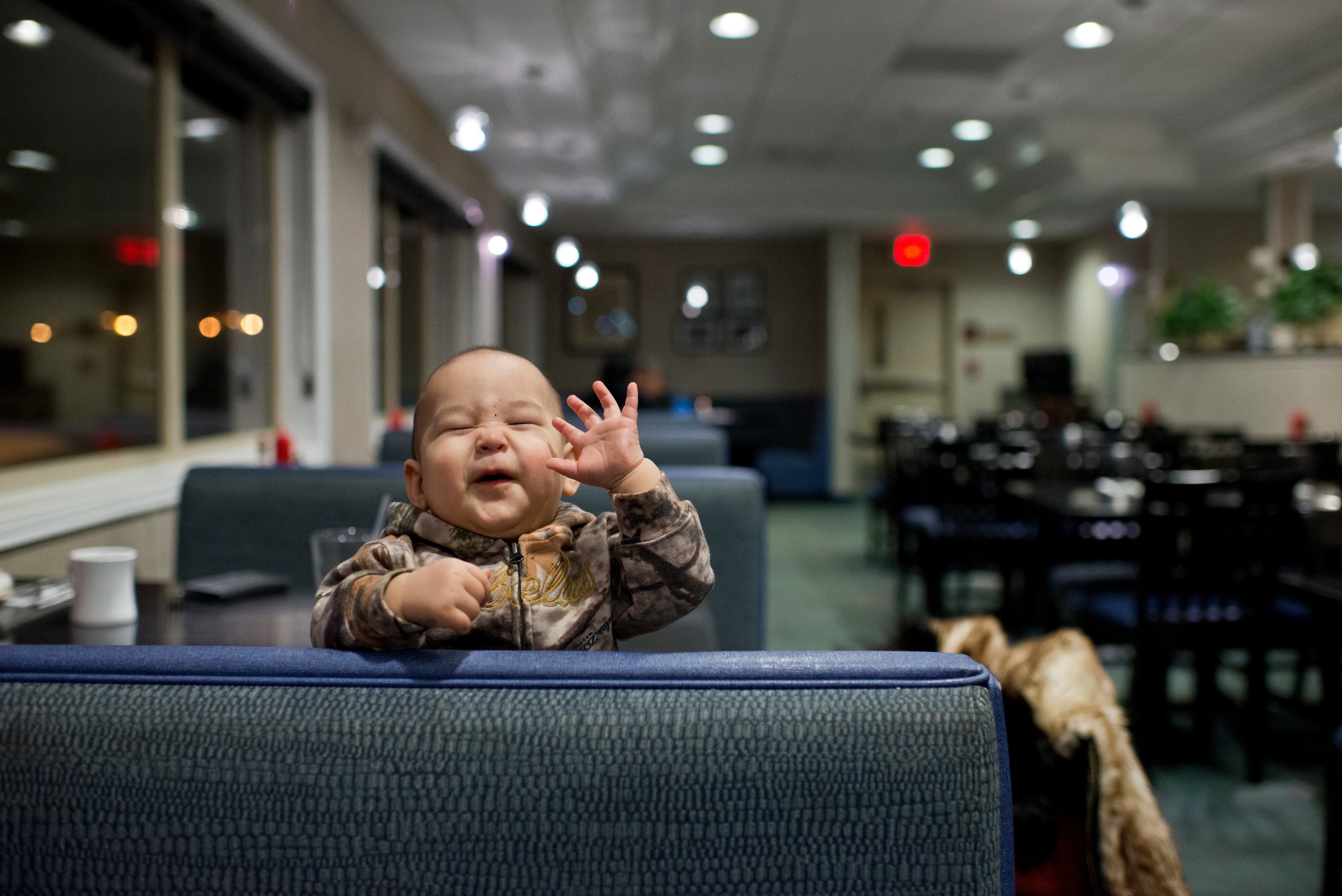 Nine-month-old Dillon Patkotak plays with his mom, Flora Patkotak while the family dined at Niggivikput, a restaurant in the Top of the World Hotel. Voters approved changing the name of the city of Barrow to Utqiagvik in October, a change which went into effect on December 1. In Alaska's northernmost city, however, residents remain divided about whether they name should've changed at all, whether the process was hurried, and whether the Utqiagvik is even the proper Inupiaq place name. Photographed on Thursday, December 15, 2016. (Marc Lester / Alaska Dispatch News)