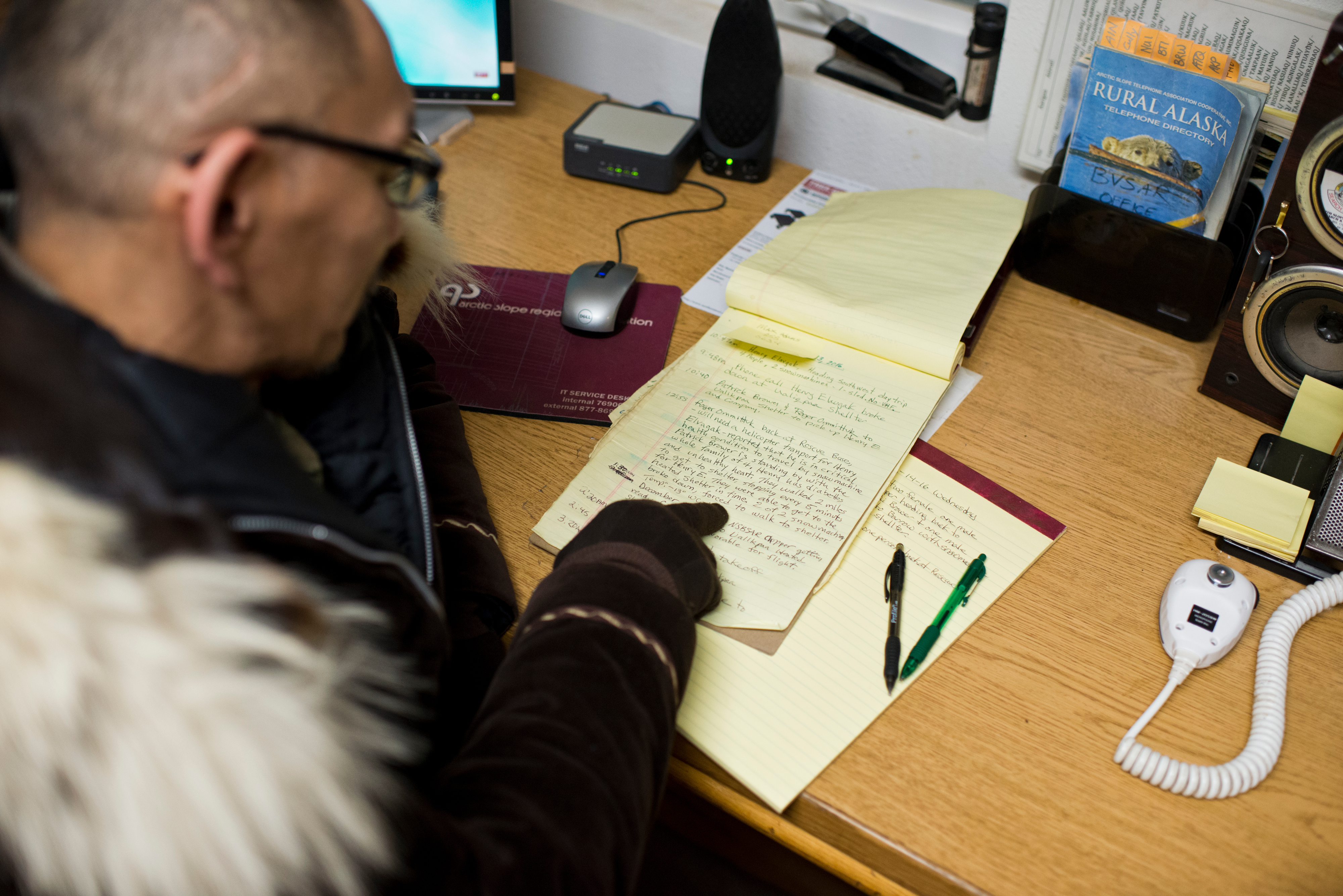 Steven Leavitt reviews a hand-written log that records the group's activities at their Utqiagvik headquarters. When someone is lost or stranded in the wild lands within 25 miles of Utqiagvik, volunteers from Barrow Search and Rescue often take they lead in retrieving them. The group also has helped map camps and cabins in the region, stake trails between village and provide emergency beacons for travelers. Photographed on Thursday, December 15, 2016. (Marc Lester / Alaska Dispatch News)