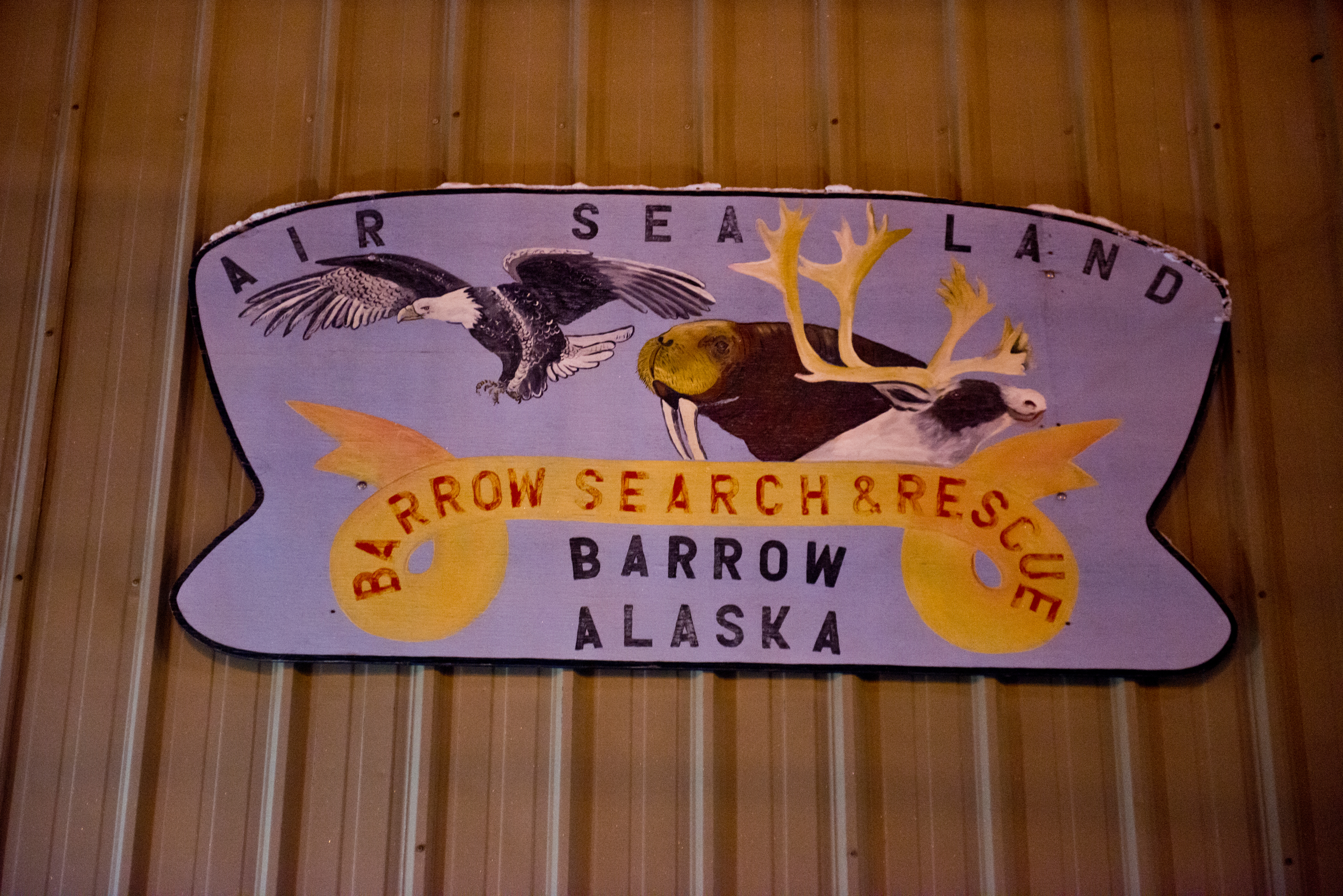 A sign marks an equipment garage in Utqiagvik for Barrow Search and Rescue. When someone is lost or stranded in the wild lands within 25 miles of Utqiagvik, volunteers from Barrow Search and Rescue often take they lead in retrieving them. The group also has helped map camps and cabins in the region, stake trails between village and provide emergency beacons for travelers. Photographed on Tuesday, December 13, 2016. (Marc Lester / Alaska Dispatch News)