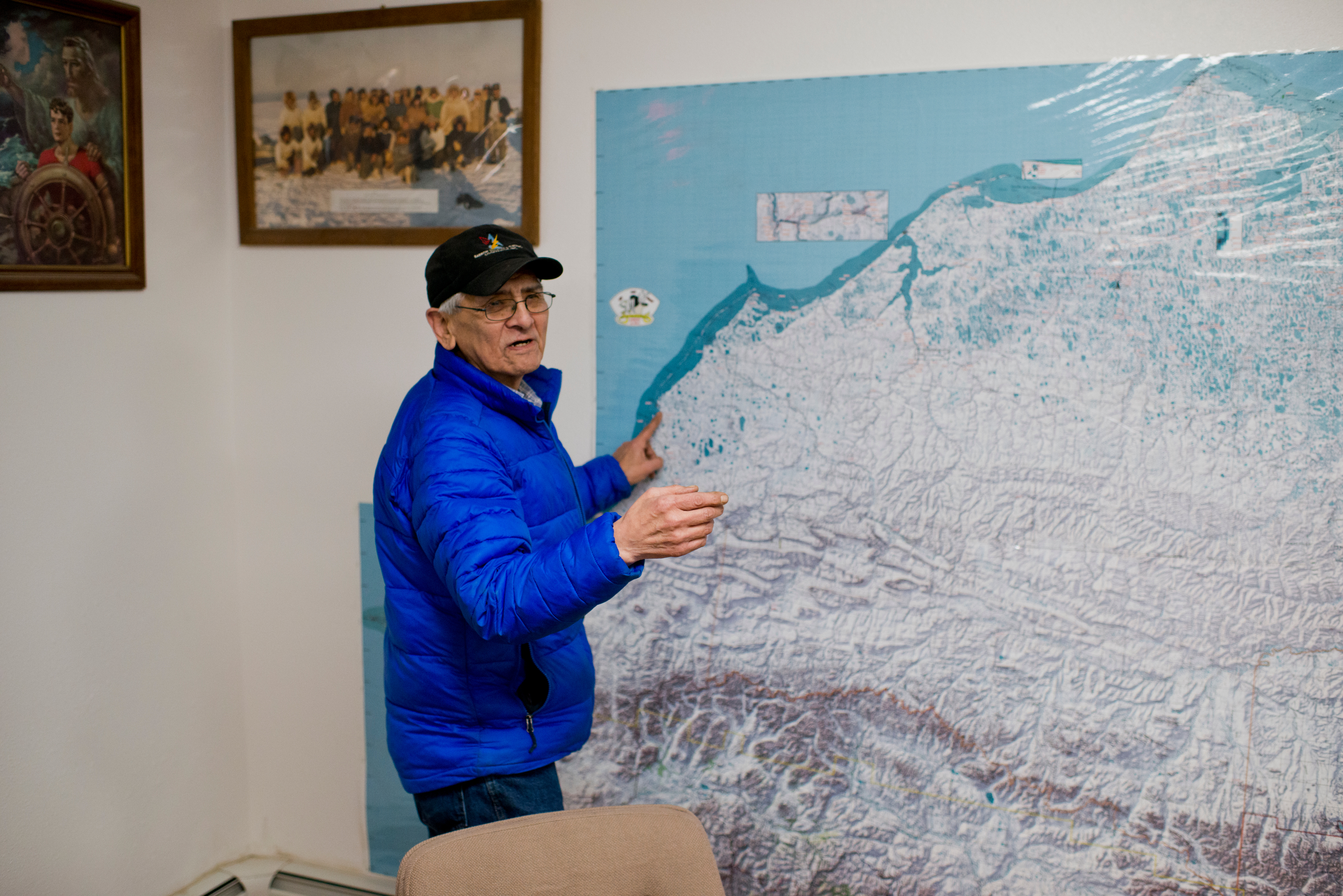 Barrow Search and Rescue vice president Johnny Adams discusses the region that the group responds. A large map in the group's headquarters marks camps and cabins on the North Slope. When someone is lost or stranded in the wild lands within 25 miles of Utqiagvik, volunteers from Barrow Search and Rescue often take they lead in retrieving them. The group also has helped map camps and cabins in the region, stake trails between village and provide emergency beacons for travelers. Photographed on Tuesday, December 13, 2016. (Marc Lester / Alaska Dispatch News)