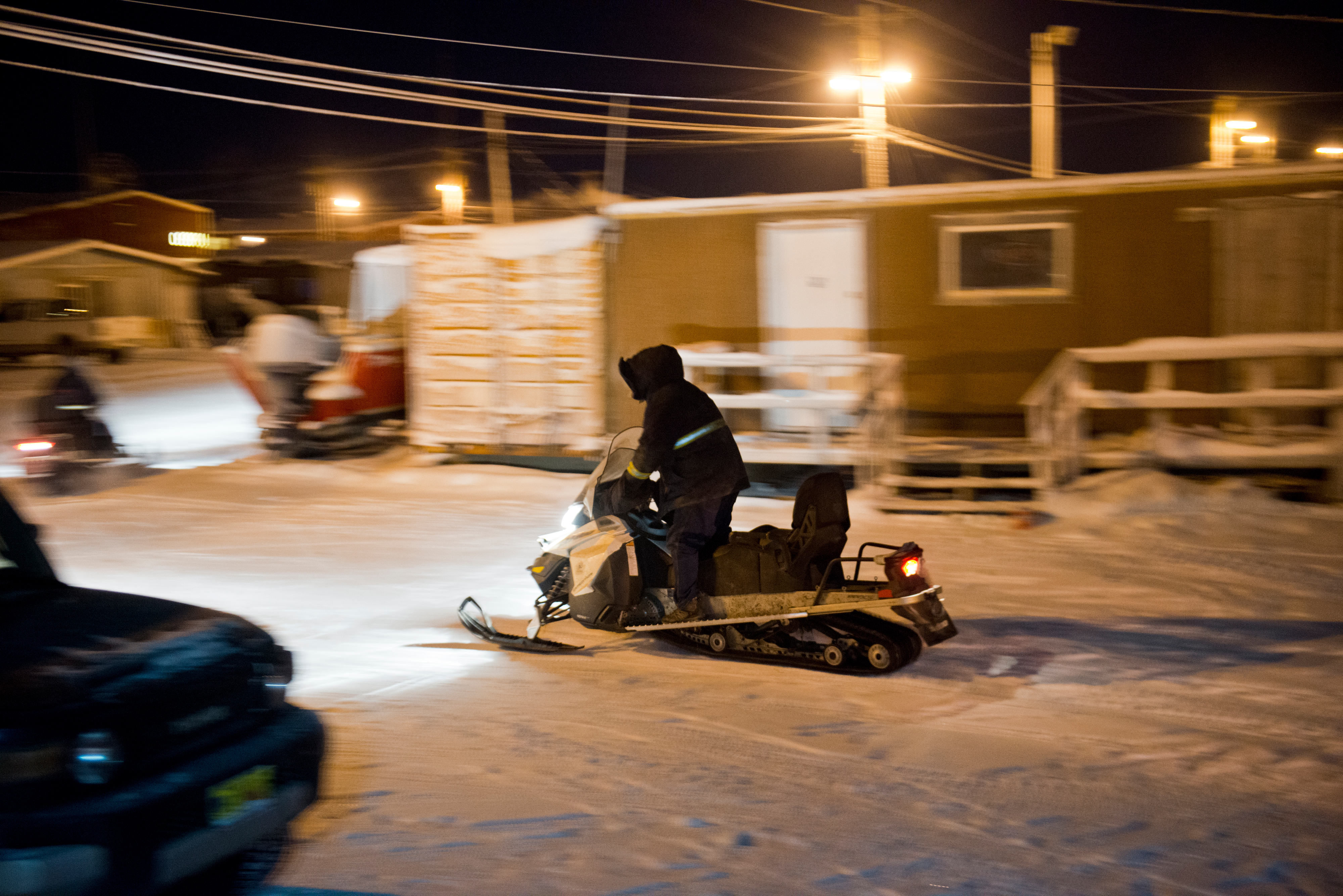 Patrick Brower departs the Barrow Searc and Rescue headquarters to assist a group of four people whose snow machines broke down while on a hunting trip. Barrow Search and Rescue volunteer Steven Leavitt said that most rescues happen within the