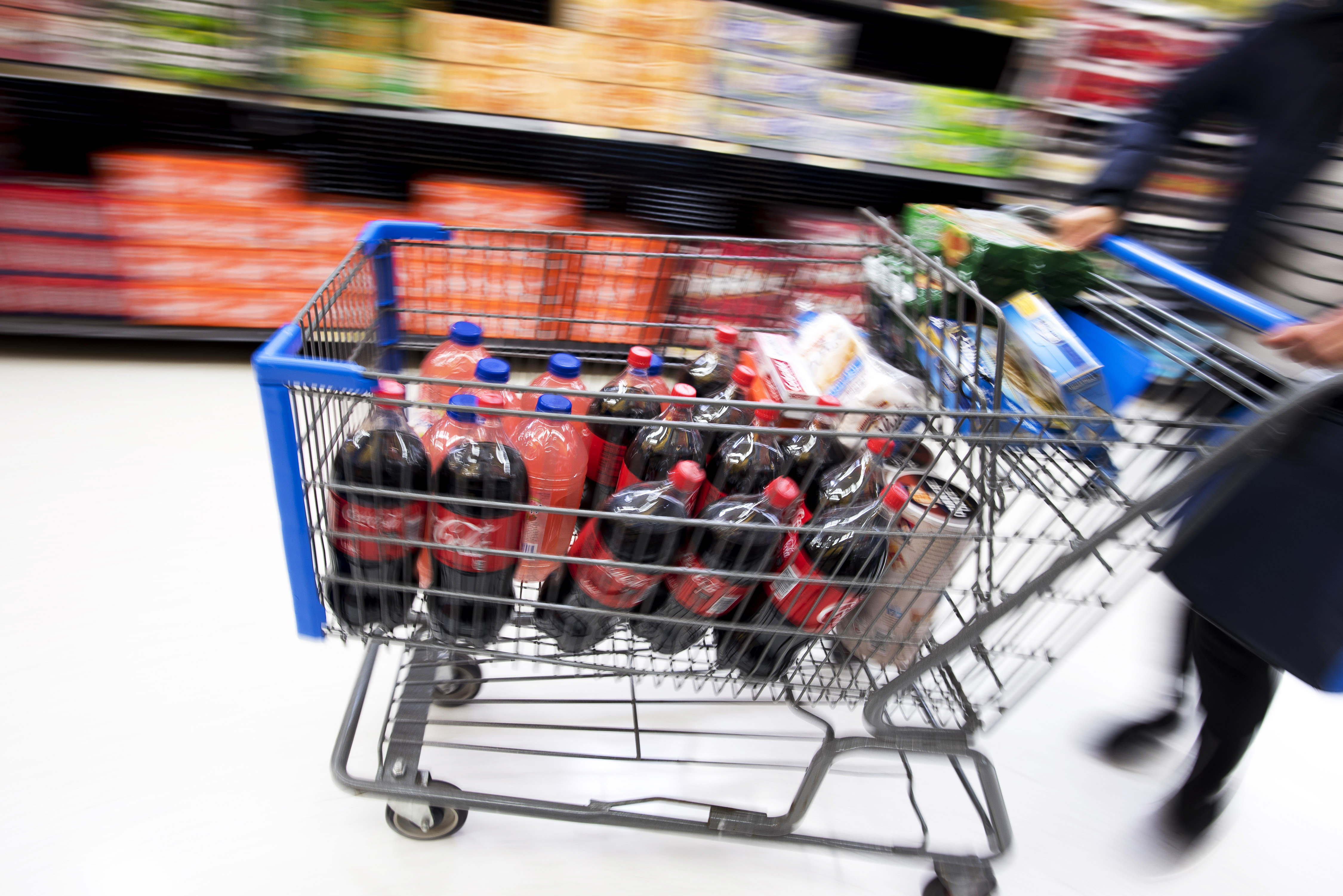 In the shopping cart of a food stamp household: Lots of soda