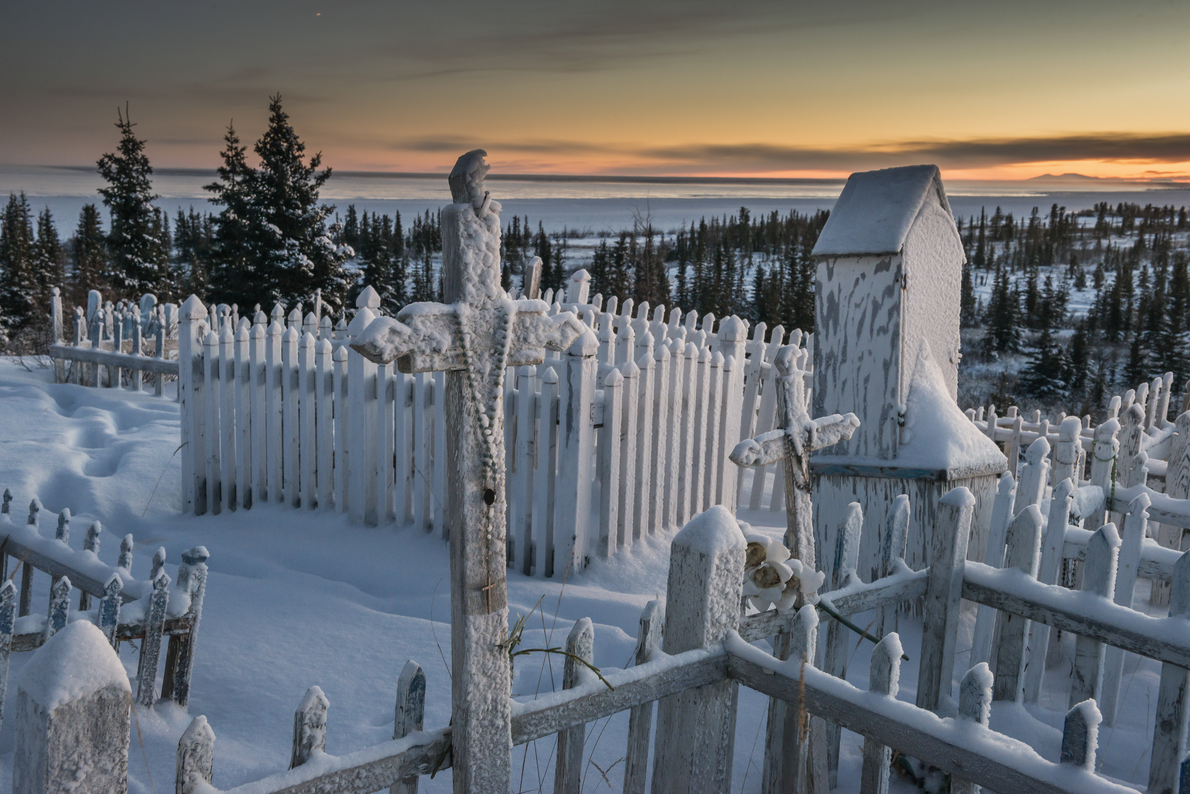 Grave sites near the edge of Great Bear Lake in Deline, a village near the