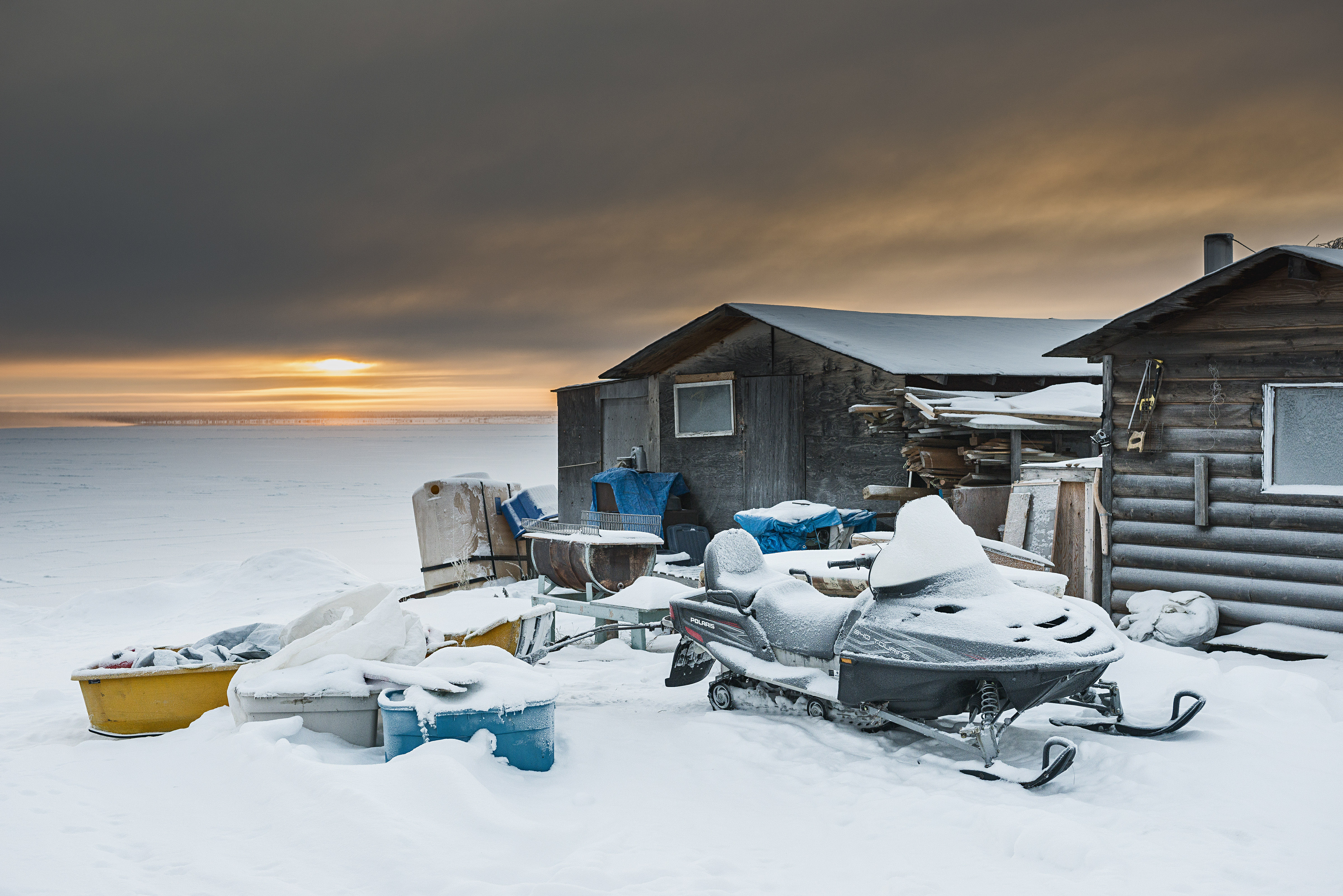 A shack on the edge of Great Bear Lake in Deline, a village near the