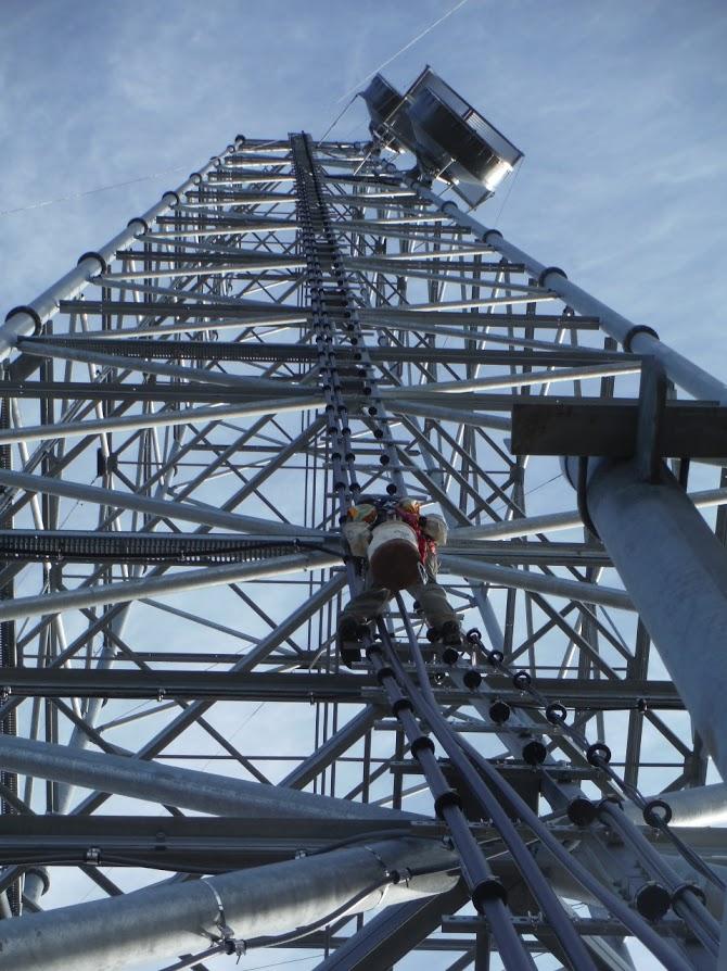 Crew place equipment on TERRA's Baldwin Peninsula tower in Western Alaska. (GCI photo)