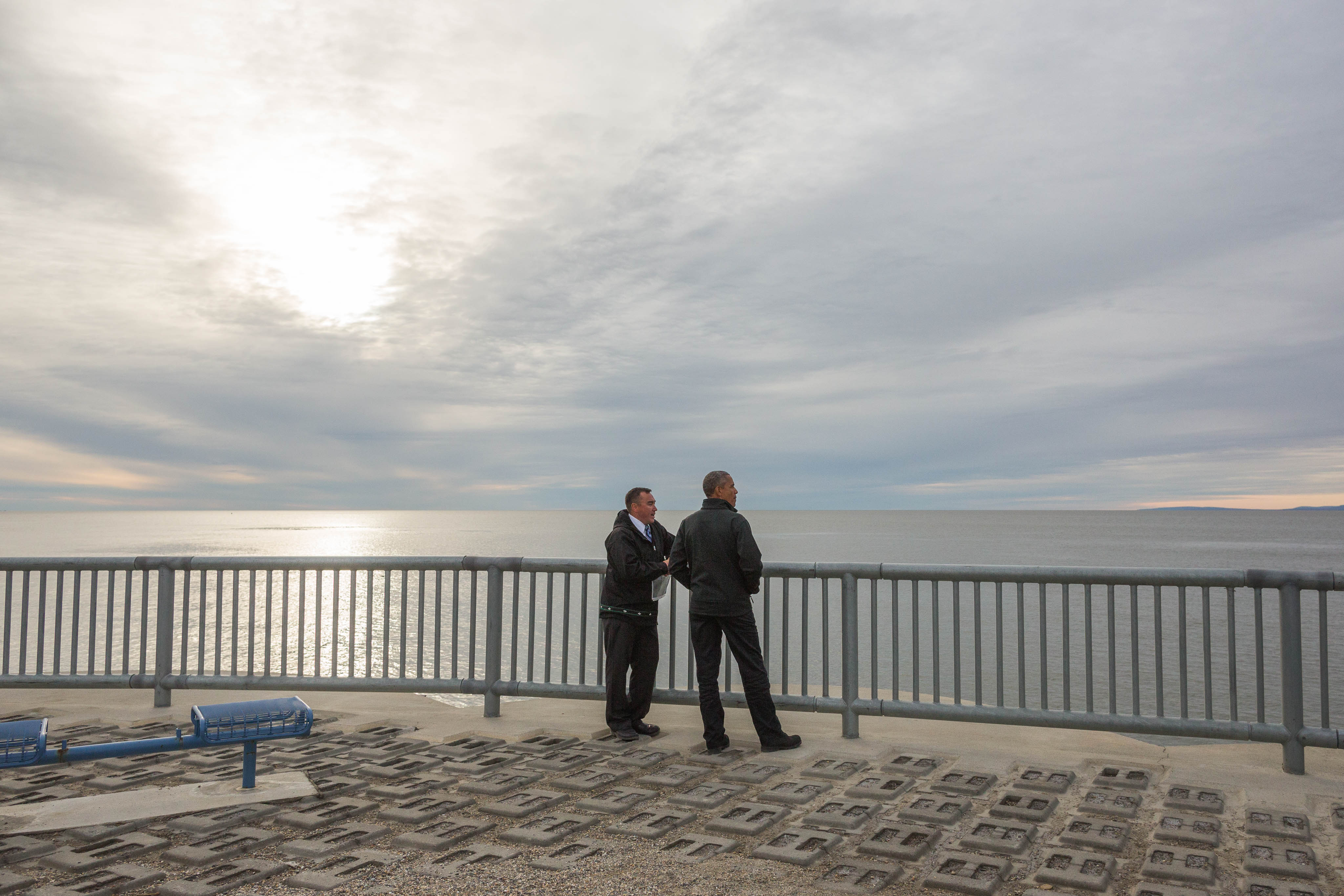 With Kotzebue City Manager Derek Martin, President Obama views the seawall that protects the community from winter storm surges on Wednesday, September 2, 2015. (Loren Holmes / ADN)