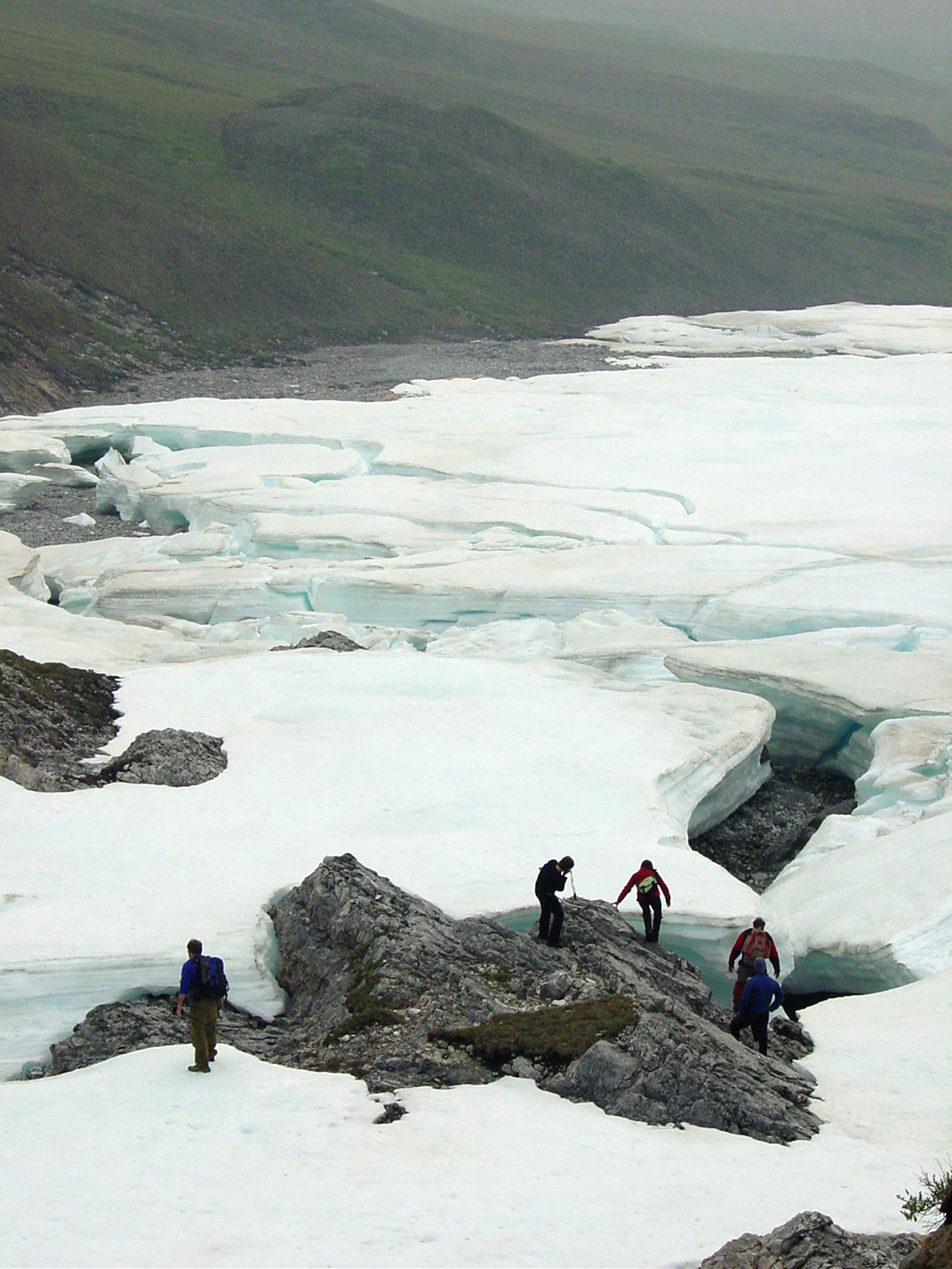 Researchers and students from the Toolik Field Station explore river icing accumulations on an unnamed river that drains into Galbraith Lake. The site is just a couple of kilometers from the Dalton Highway and at the northeastern part of Gates of the Arctic National Park and Preserve. Also known as aufeis, the image was made in the mid-2000s. (Jay Zarnetske / Michigan State University)