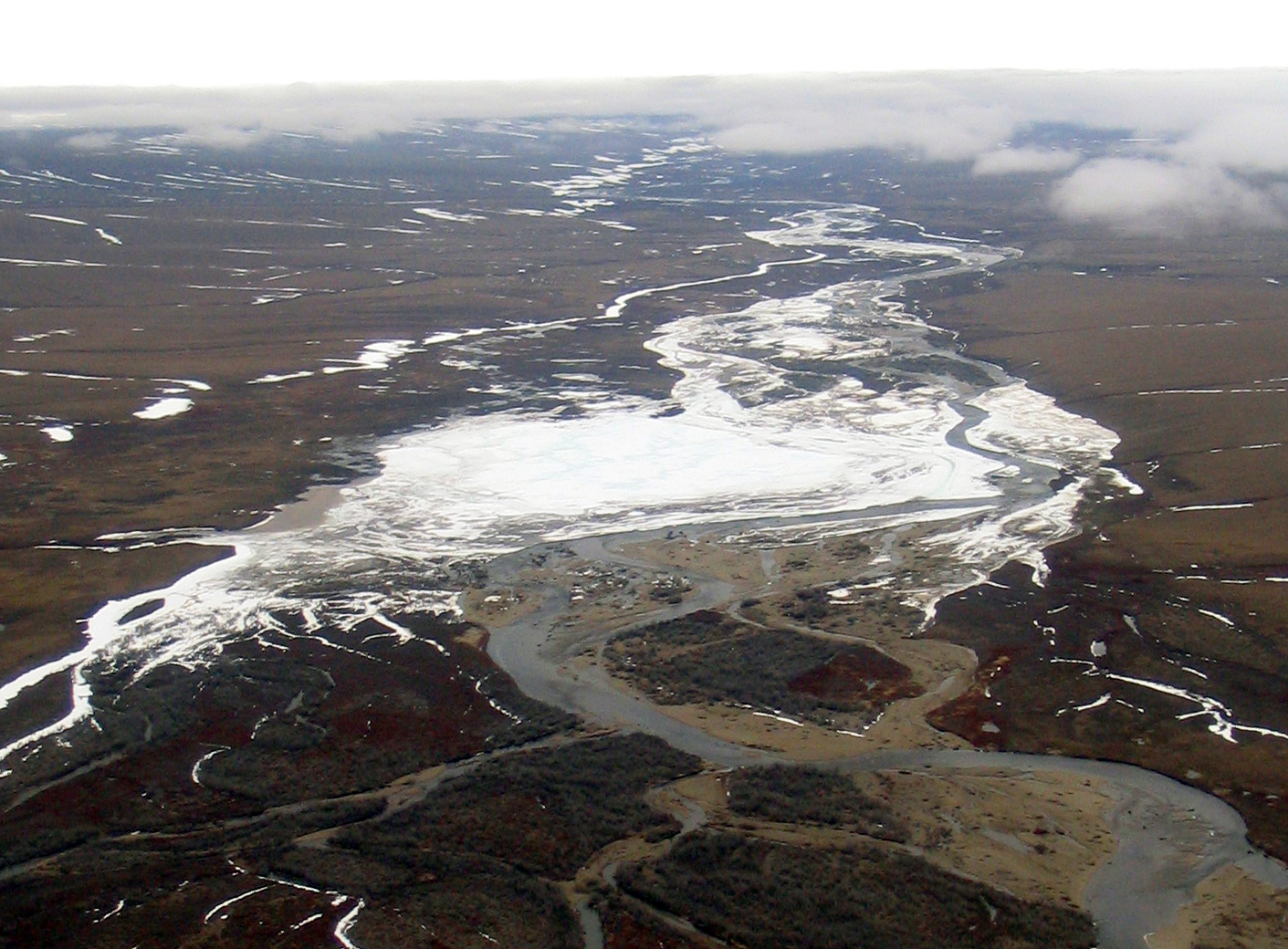 The Kuparuk River has river icing just north of the Toolik Field Station. Also known as aufeis, the image was made in the mid-2000s. (Jay Zarnetske / Michigan State University)