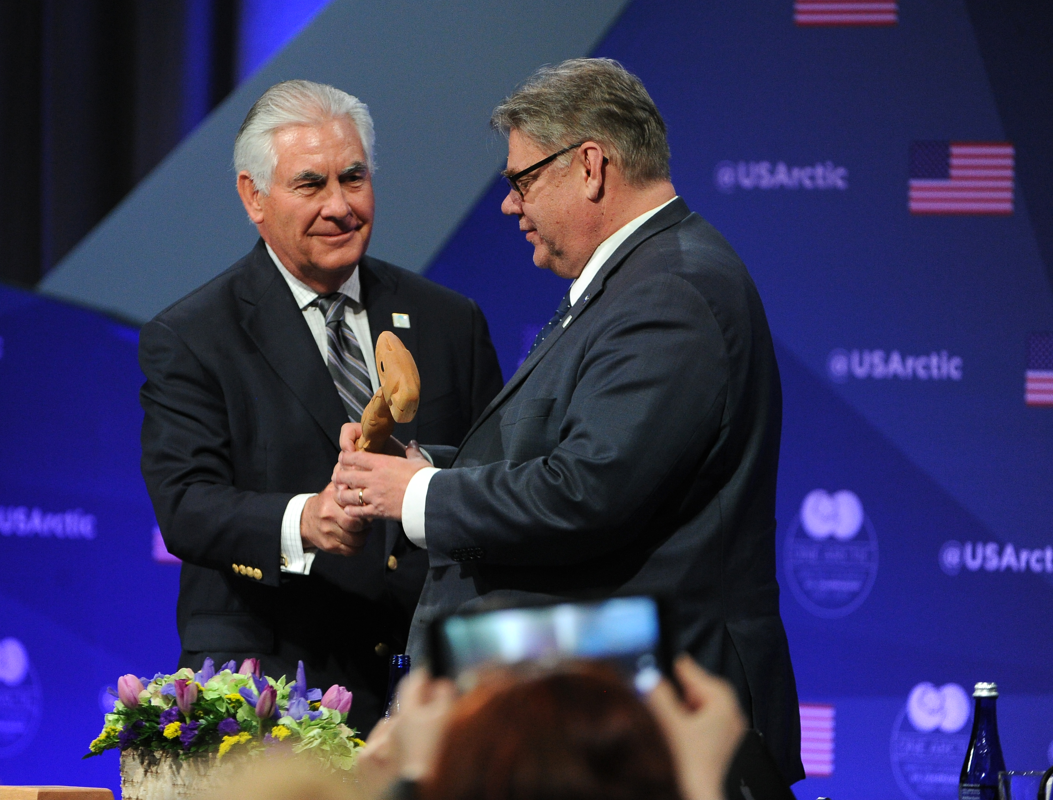 US Secretary of State Rex Tillerson pass the gavel to the Minister of Foreign Affairs of Finland, Timo Soini, as the chair of the Arctic Council is passed to Finland at the Carlson Center in Fairbanks, Alaska on Thursday, May 11, 2017. (Bob Hallinen / Alaska Dispatch News)