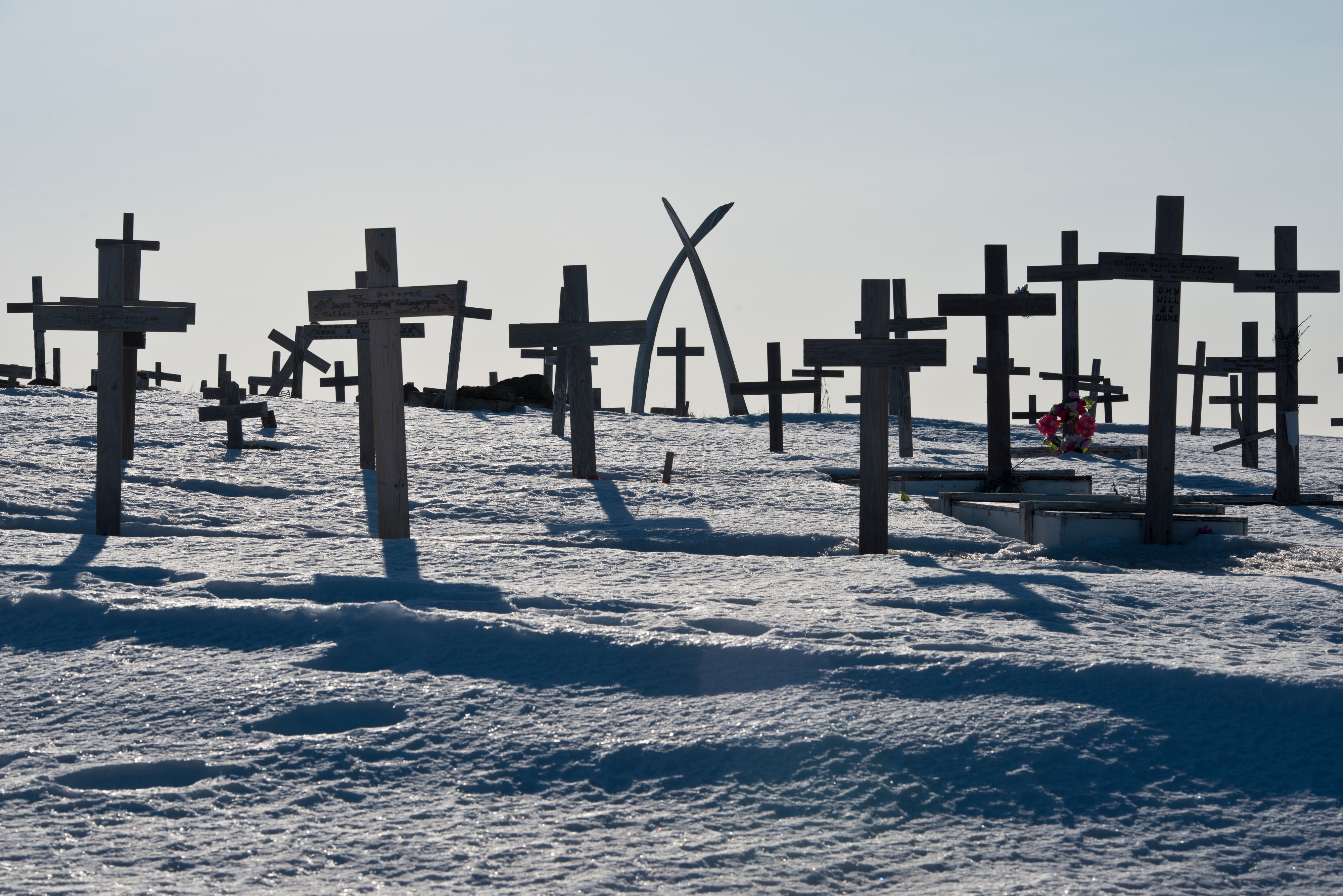 Whale bones create an archway over crosses at the Savoonga cemetery on April 20, 2017. (Marc Lester / Alaska Dispatch News)