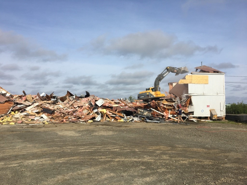 Demolition work on the building that housed the state Office of Children's Services in Bethel, Alaska, continues on June 22, 2017. The building suffered interior damage while being leveled in Oct. 2016. (Lisa Demer / Alaska Dispatch News)