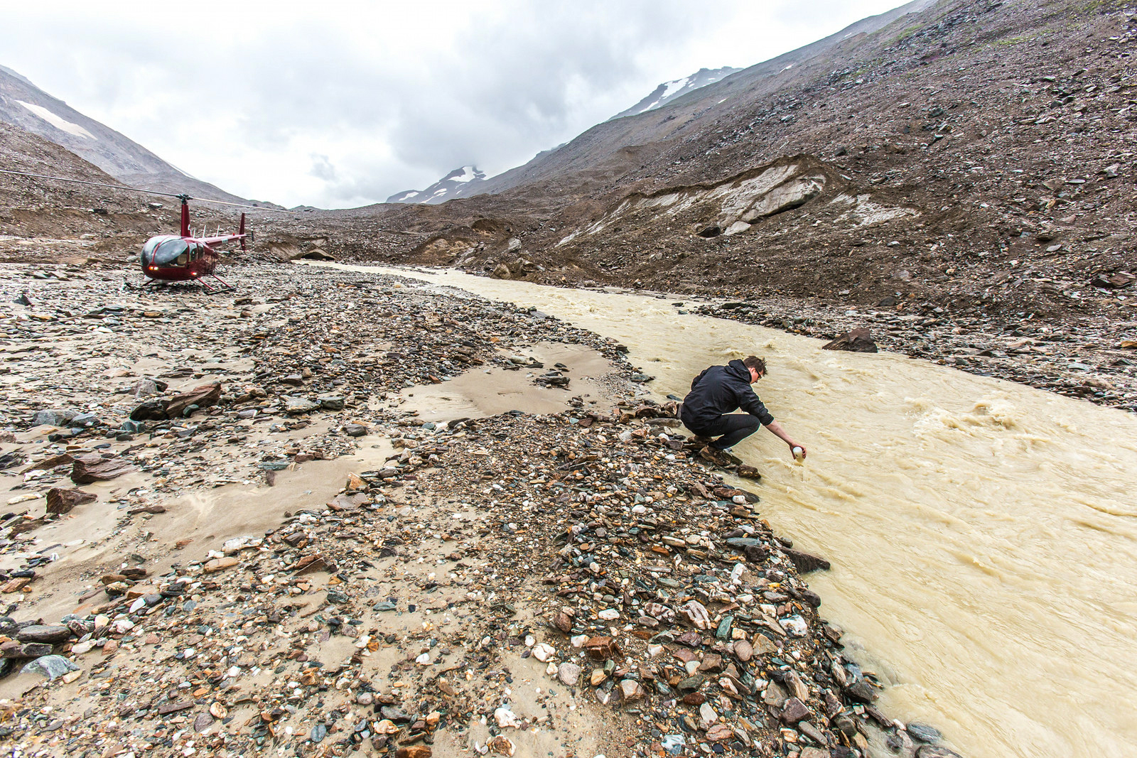 UAF researchers grab a water sample for geochemical analysis at the mouth of the Jarvis Glacier in 2014. Jarvis Glacier is in the Alaska Range south of Delta Junction. (Todd Paris / UAF)
