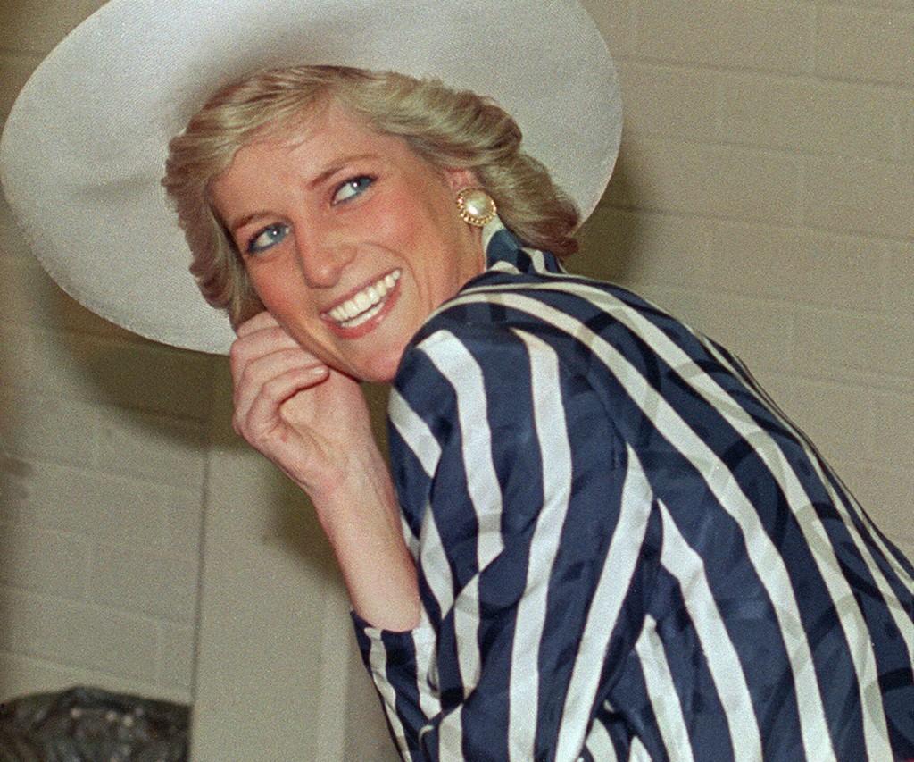 Diana y una sonrisa irresistible para los paparazzis del mundo.