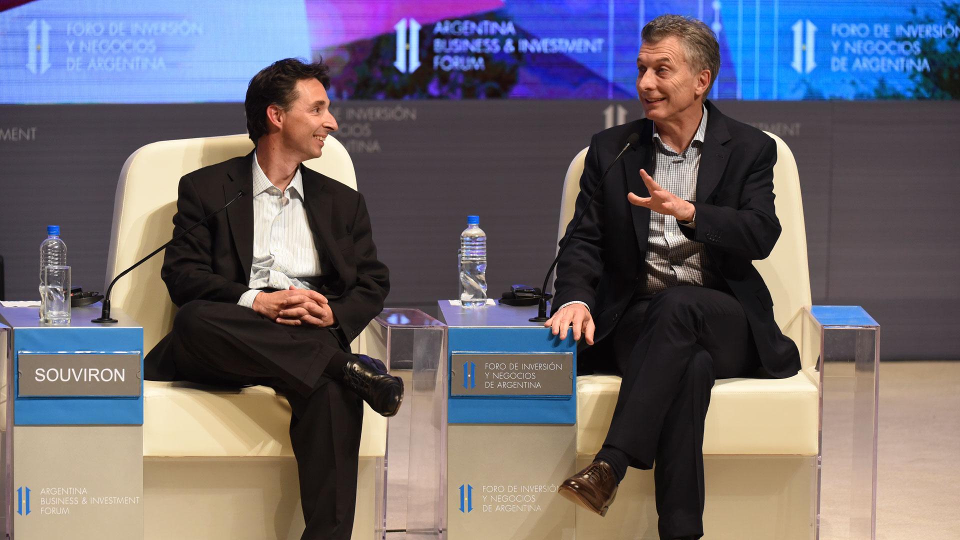 Mauricio Macri y Roberto Souviron, de Despegar (AFP)