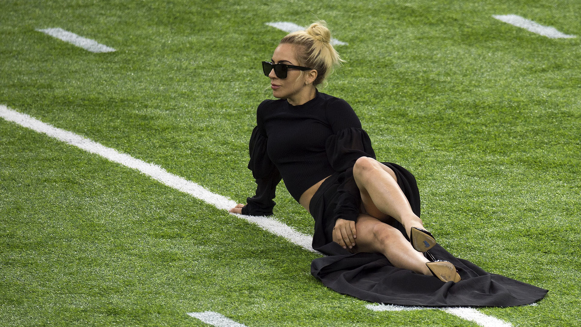 Singer Lady Gaga poses on the field at the Super Bowl LI before the start of the game at Houston NRG Stadium in Houston, Texas, on February 5, 2017. / AFP PHOTO / VALERIE MACON