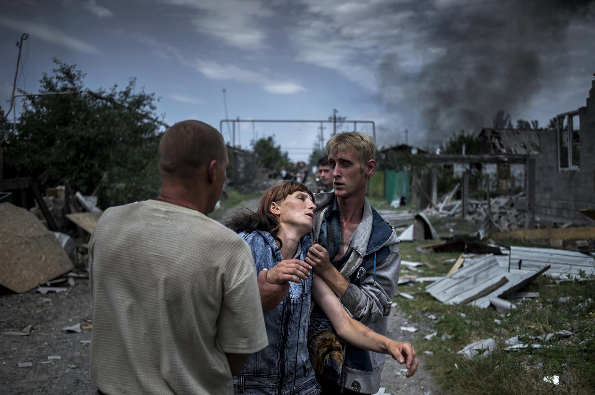 Proyectos a Largo Plazo, primer premio. Gente de la ciudad deLuhanskaya luego de un ataque aéreo. Valery Melnikov, Rossiya Segodnya
