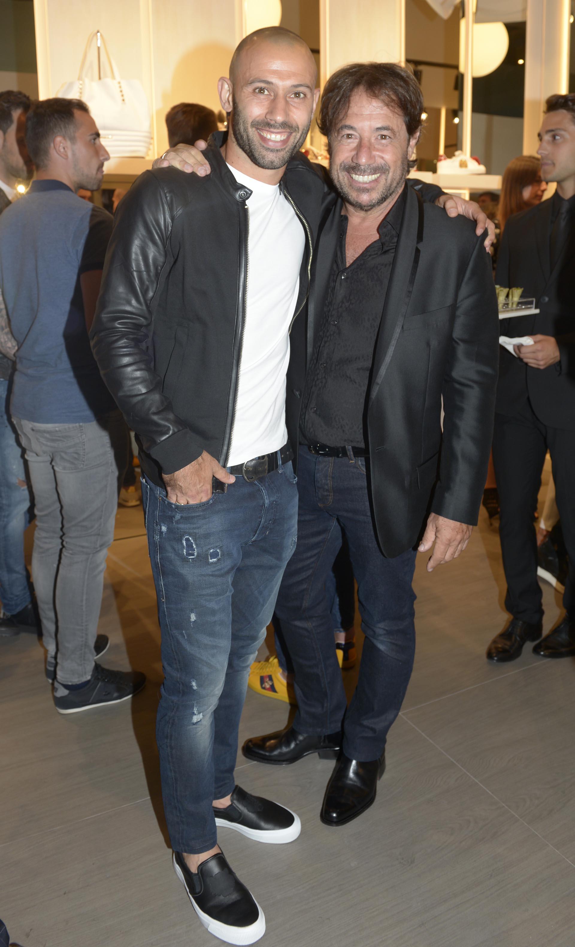 Javier Mascherano y Ricky Sarkany
