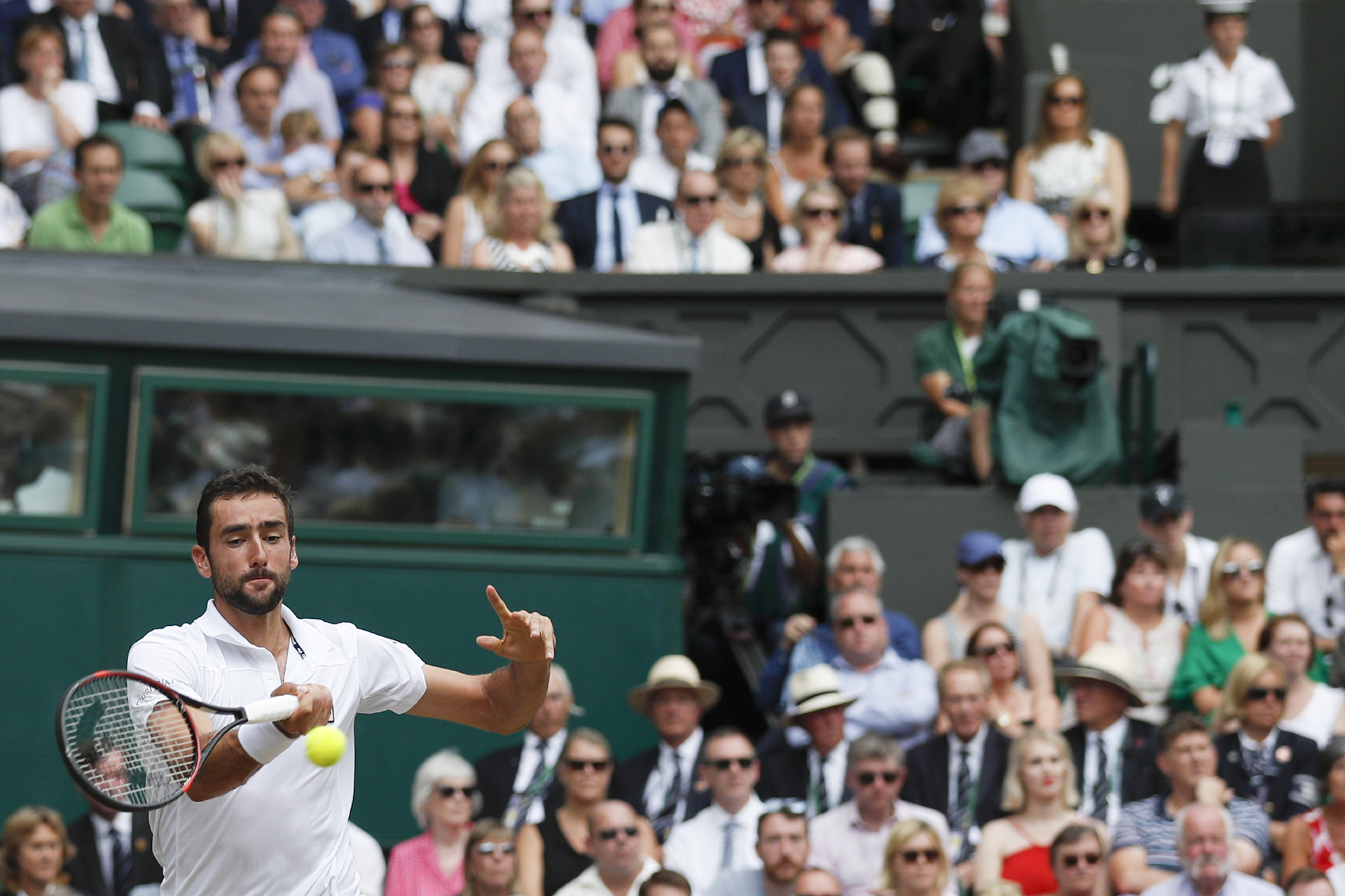 Croatia's Marin Cilic returns against Switzerland's Roger Federer during their men's singles final match on the last day of the 2017 Wimbledon Championships at The All England Lawn Tennis Club in Wimbledon, southwest London, on July 16, 2017. / AFP PHOTO / Adrian DENNIS / RESTRICTED TO EDITORIAL USE