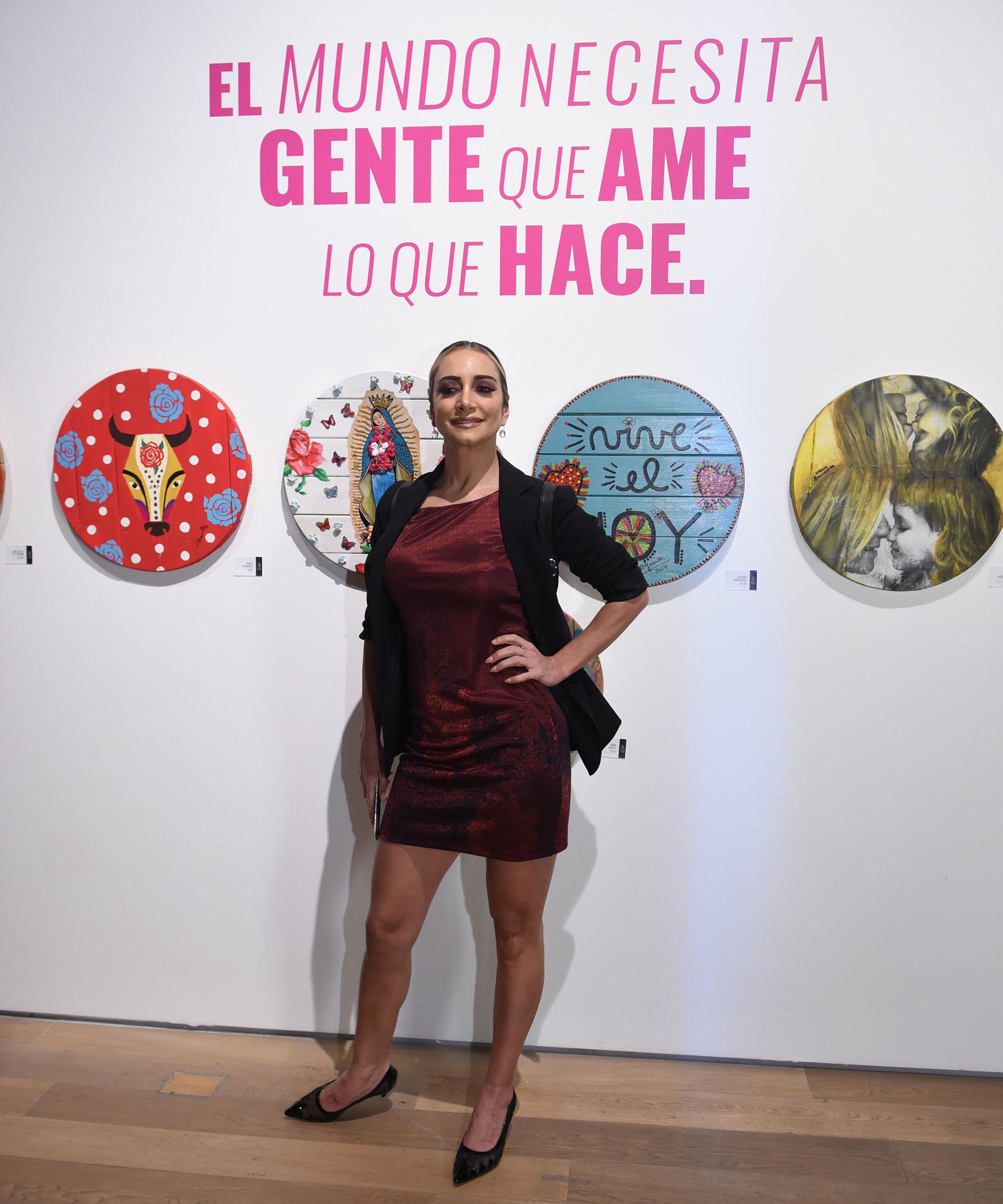 """Andrea Ghidone. Los pallets de 1 metro de diámetro, aproximadamente, fueron intervenidos con total libertad de texturas y colores, transformándose en un gran vehículo para ayudar a quienes más lo necesitan. """"El pallet es el soporte inspirador en el cual vive la obra realizada por los artistas convocados"""", destacó Paula Rivero, curadora de esta edición"""