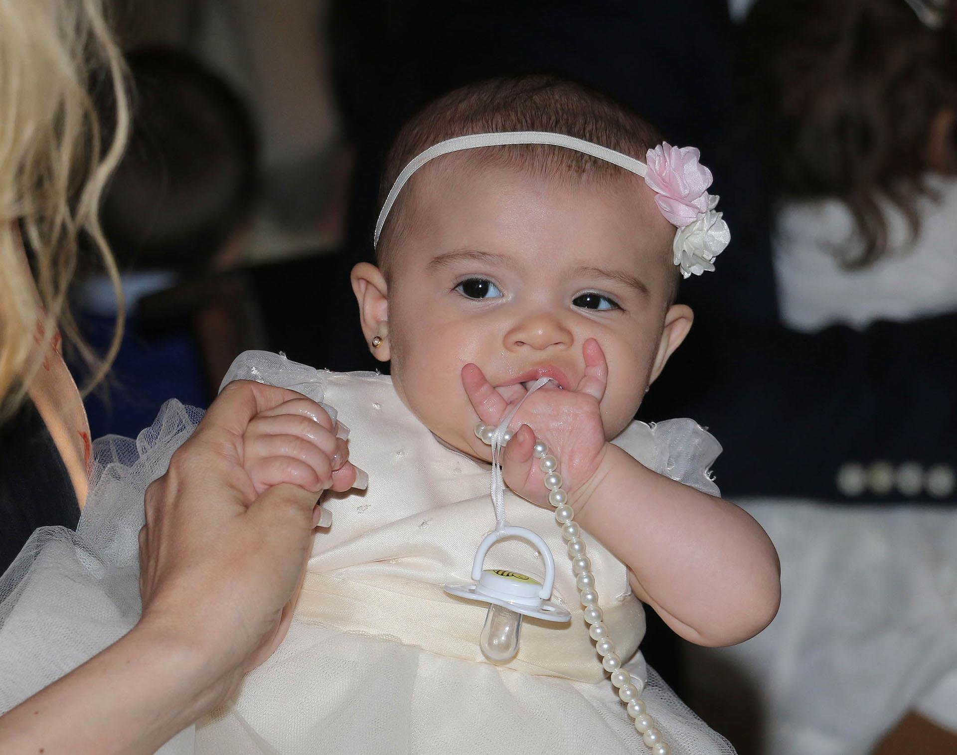 La pequeña Indiana en su bautismo