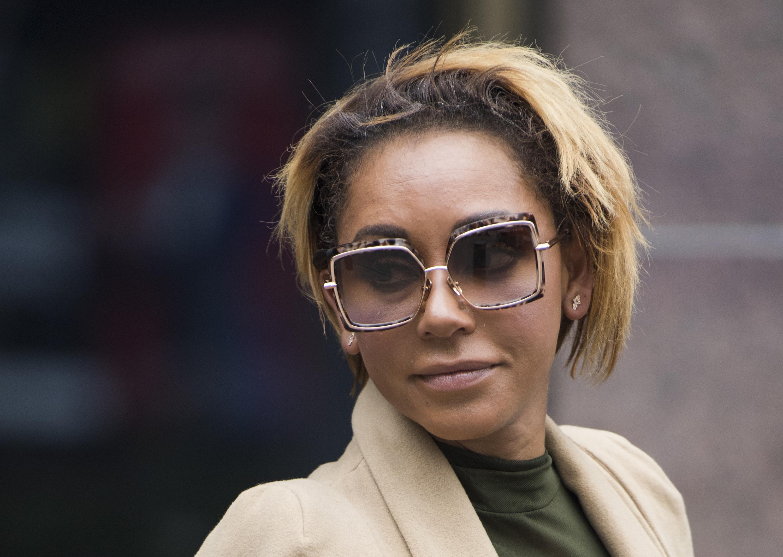 Melanie Brown (la ex Spice Girl Mel B) dejando la corte de Los Angeles (AFP PHOTO /Robyn Beck)