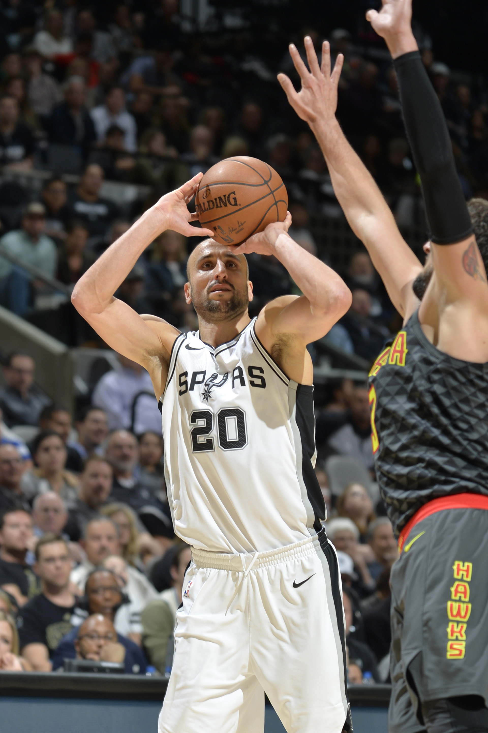 SAN ANTONIO, TX - NOVEMBER 20: Manu Ginobili #20 of the San Antonio Spurs goes for a shot against the Atlanta Hawks on November 20, 2017 at the AT&T Center in San Antonio, Texas. NOTE TO USER: User expressly acknowledges and agrees that, by downloading and or using this photograph, user is consenting to the terms and conditions of the Getty Images License Agreement. Mandatory Copyright Notice: Copyright 2017 NBAE Mark Sobhani/NBAE via Getty Images/AFP