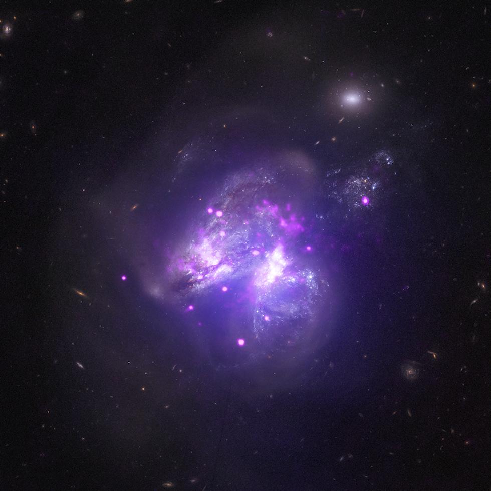 El sistema de dos galaxias Arp 299, a 140 millones de años luz de la Tierra (NASA/CXC/Univ of Crete/K. Anastasopoulou et al, NASA/NuSTAR/GSFC/A. Ptak et al., NASA/STScI)