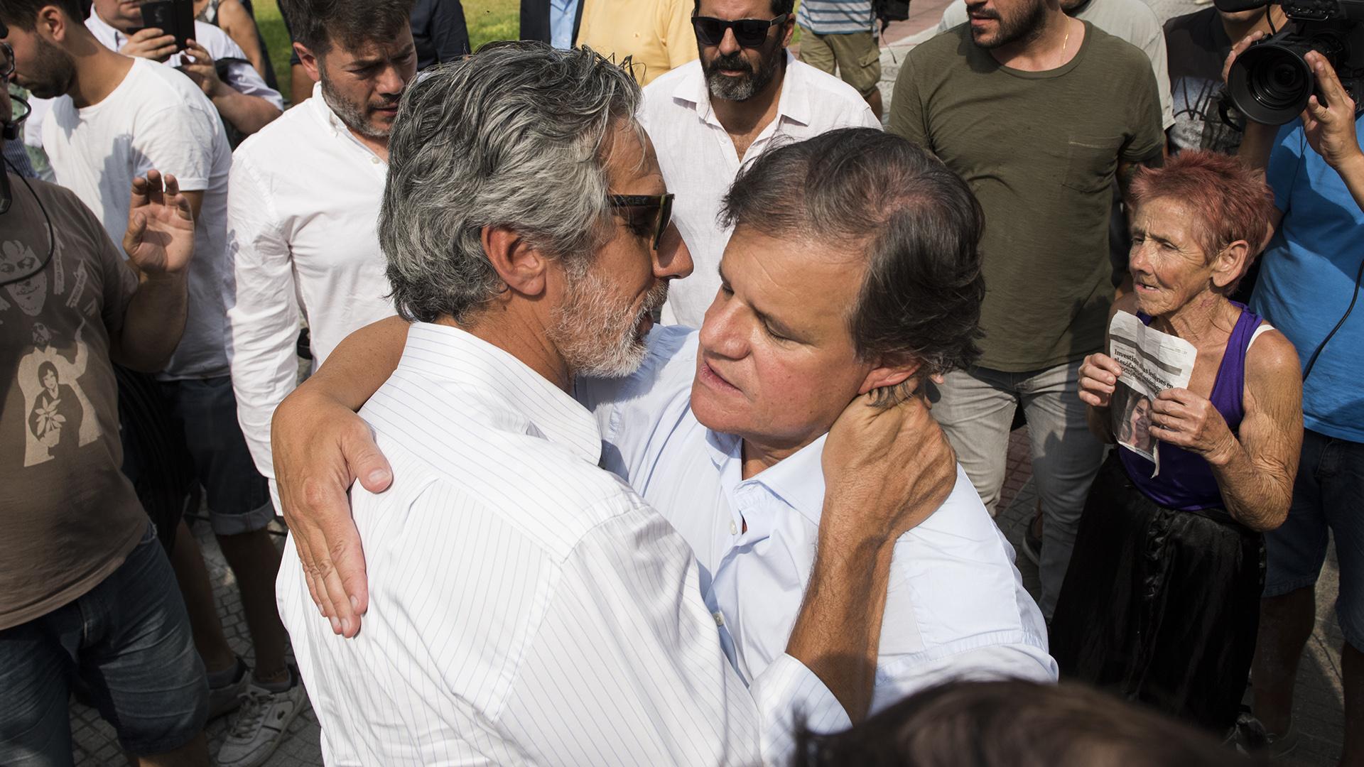 Juan Miceli saluda a Enrique Sacco
