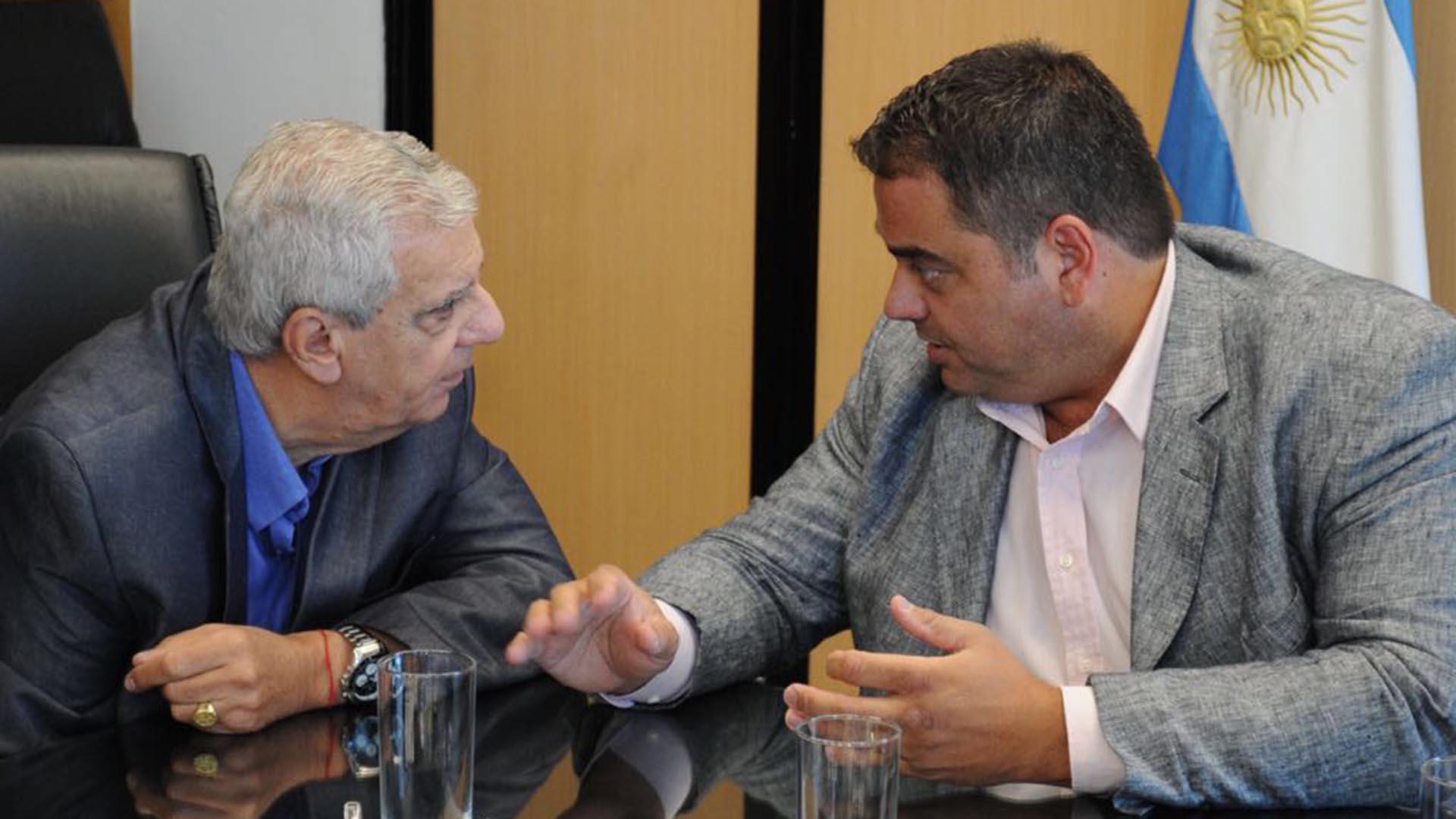 El ministro de Trabajo, Jorge Triaca, y el sindicalista José Luis Lingeri