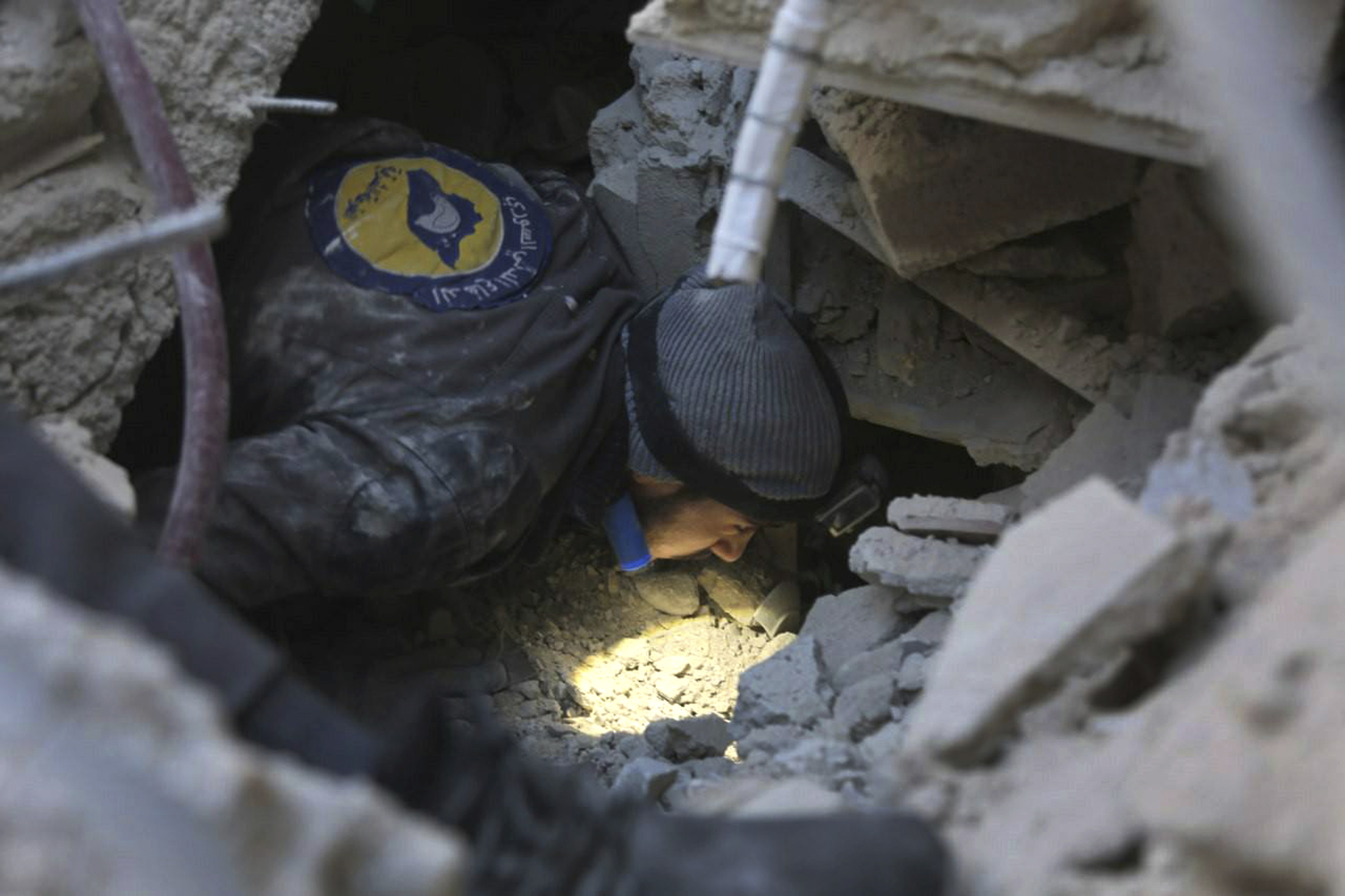 (Syrian Civil Defense White Helmets via AP)