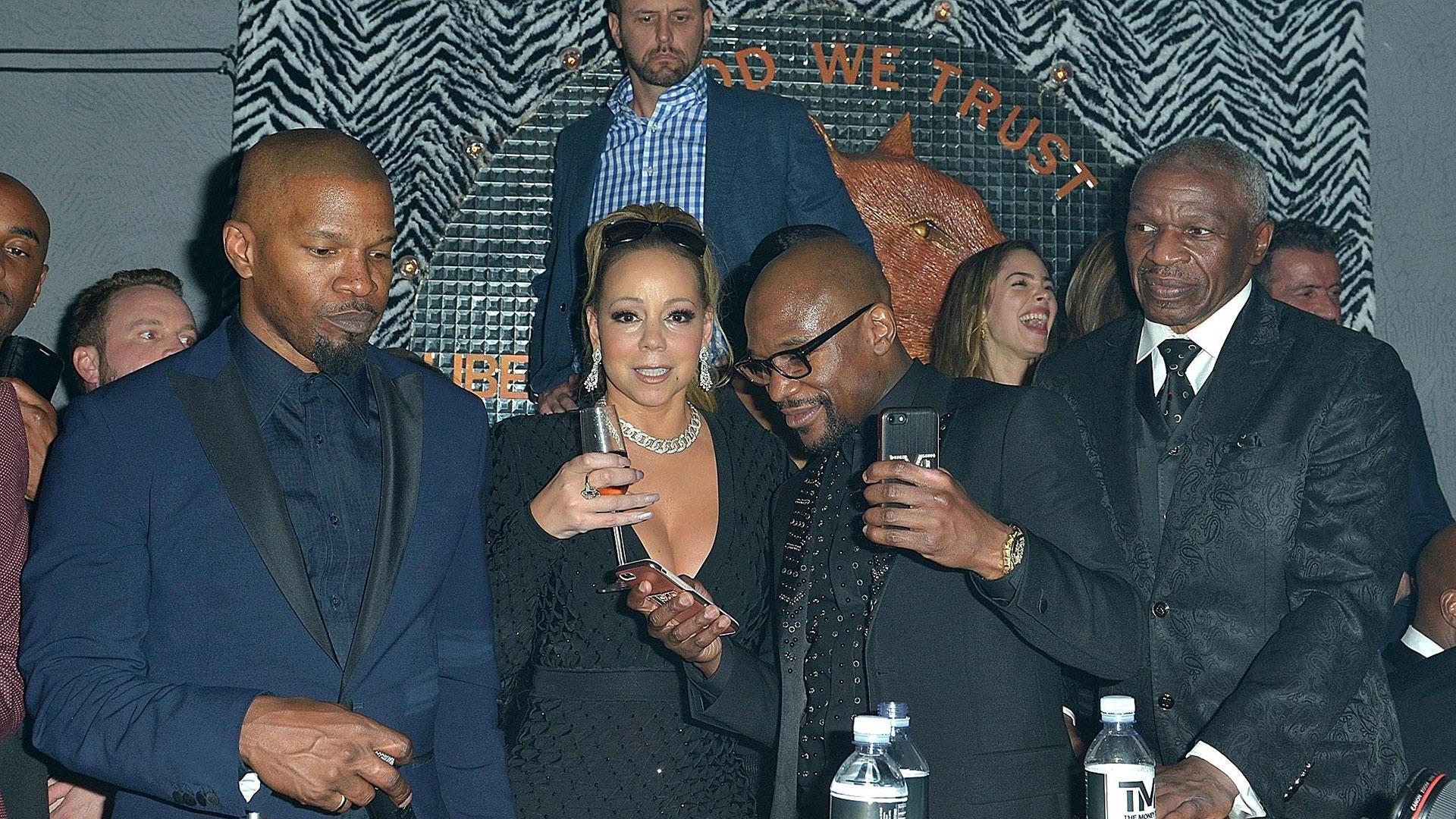 Jamie Foxxx, Mariah Carey, Mayweather y su padre, durante el evento (Grosby Group)