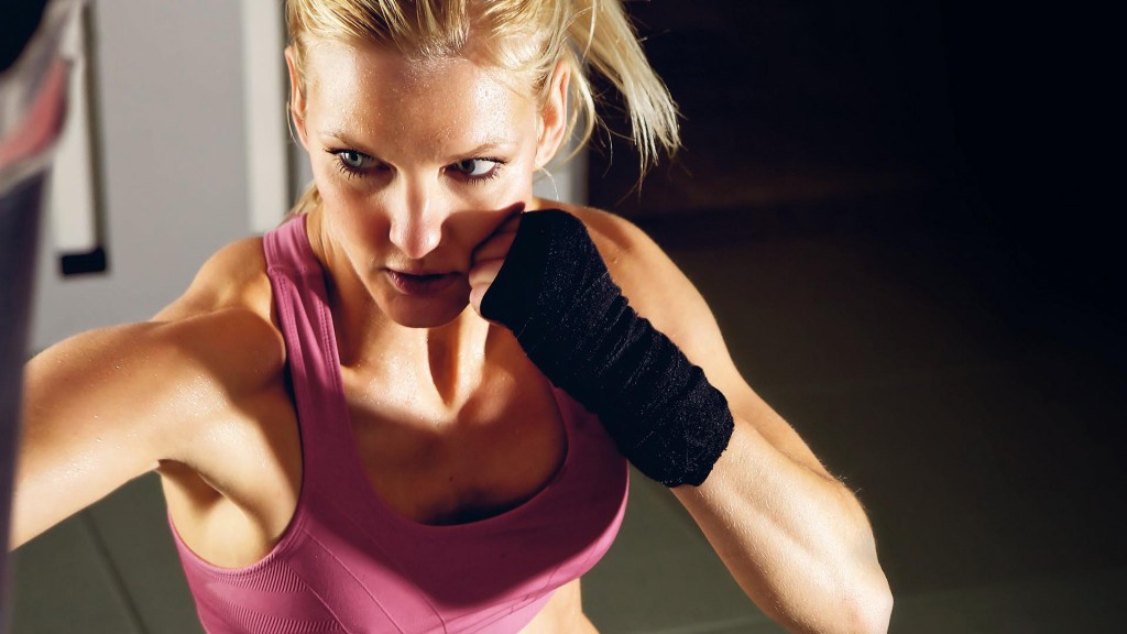 CFKP2D Young adult fitness woman boxing in a gym