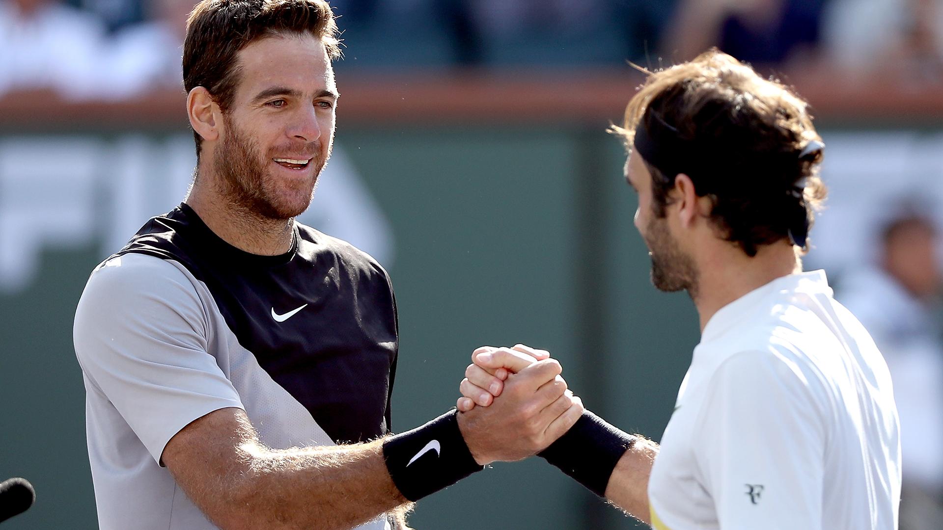 Fue el duelo número 25 entre ambos tenistas: Federer tiene ventaja de 18-7. Delpo gana 4-2 en finales (AFP)
