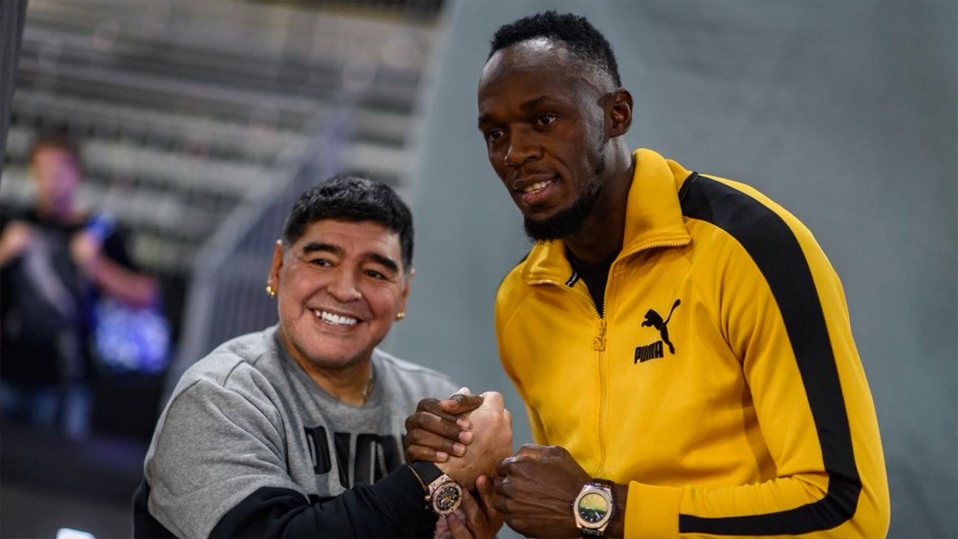 Usain Bolt junto a Diego Armando Maradona en un evento comercial