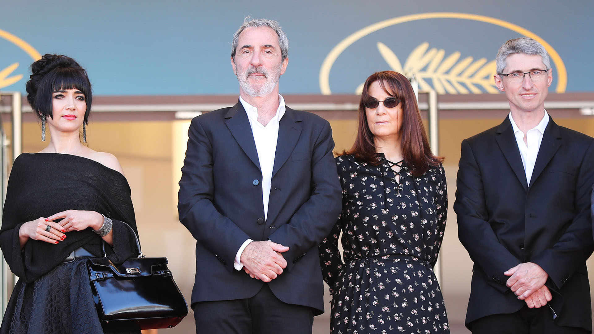 La productora francesa Nicole Brenez, el productor francés Jean-Paul Battaggia, la productora francesa Nicole Brenez y el director de fotografía suizo Fabrice Aragno (AFP)