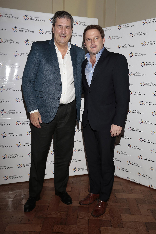 El ministro de Infraestructura y Servicios Públicos, Roberto Gigante, y Alex Campbell