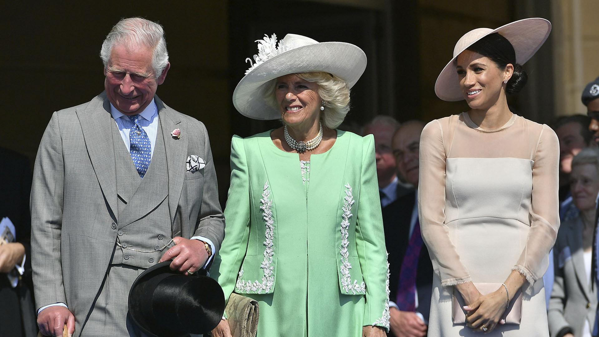 En el marco de la celebración de los 70 años del príncipe Carlos, junto a Camilla Parker Bowles, Meghan Markle deslumbró en su primera aparición pública como duquesa. Fue el 22 de mayo(AFP)