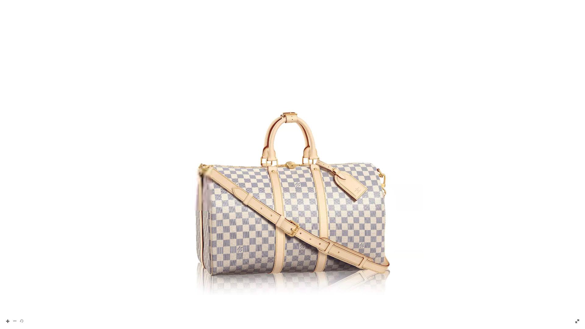 El bolso de viaje Keepall en su versión de 45′ con correa y tarjeta de identidad con lienzo de Damier en blanco, gris y off white. Este modelo se destaca por la combinación entre la elegancia y sofisticación para un viaje de ensueño.