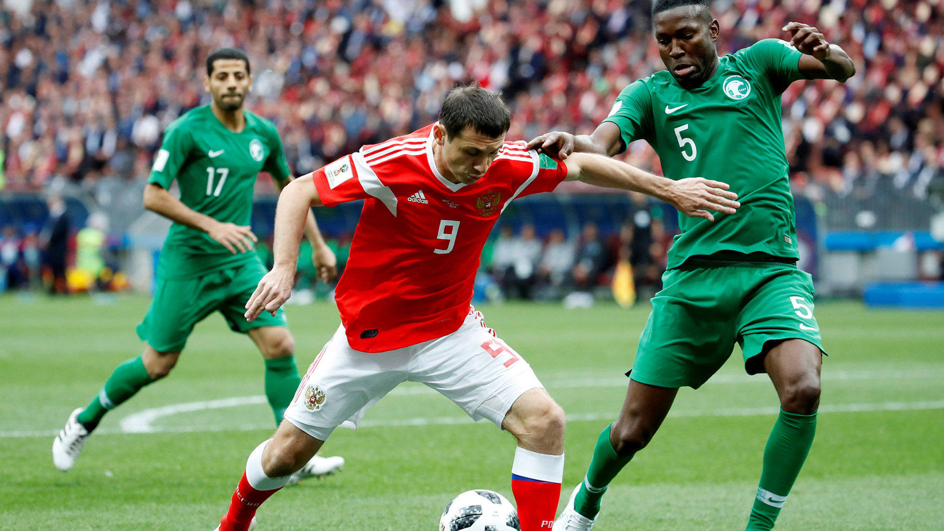 Soccer Football – World Cup – Group A – Russia vs Saudi Arabia – Luzhniki Stadium, Moscow, Russia – June 14, 2018   Russia's Alan Dzagoev in action with Saudi Arabia's Omar Hawsawi    REUTERS/Christian Hartmann