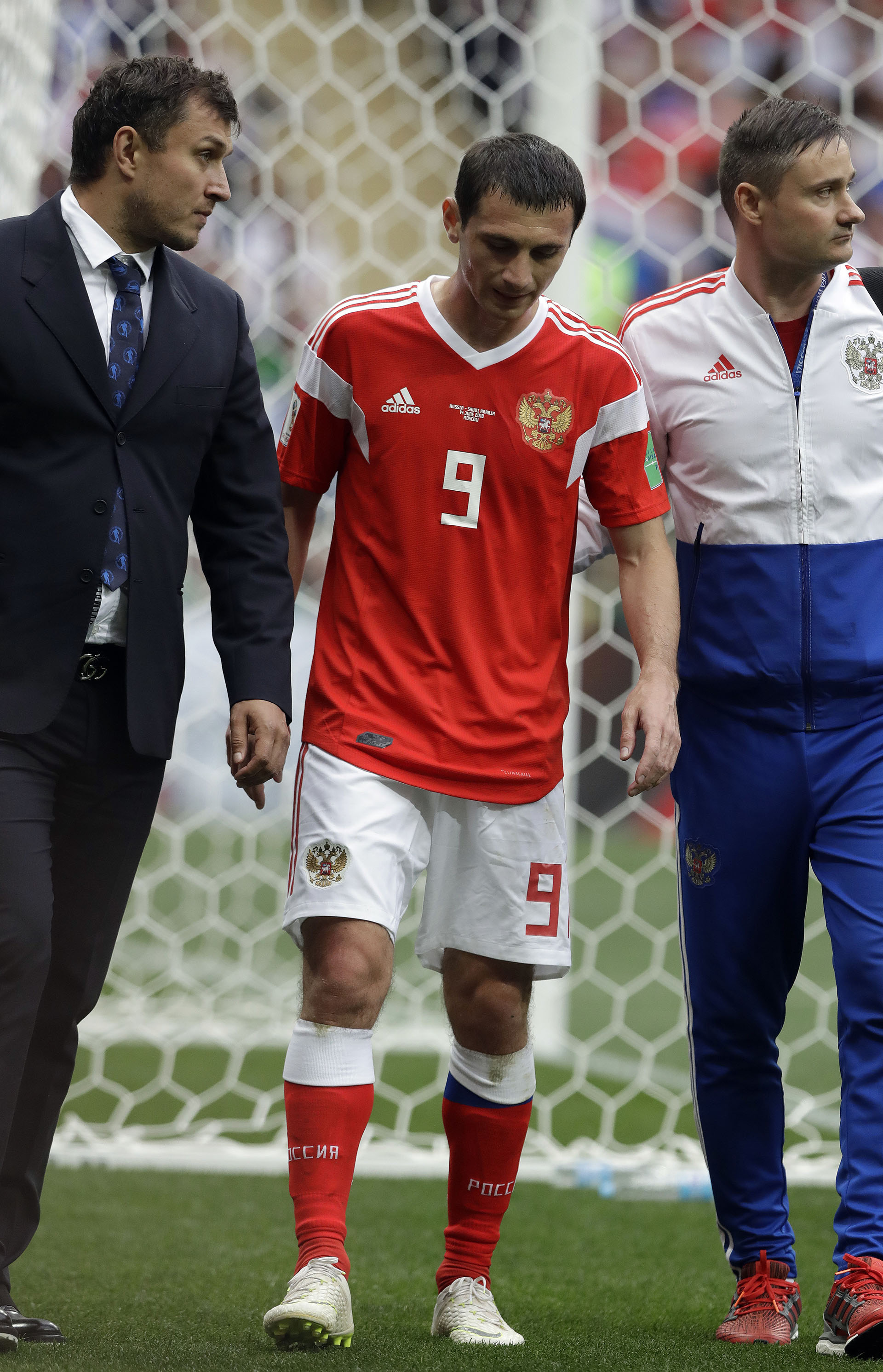 Russia's Alan Dzagoev leaves the pitch injured during the group A match between Russia and Saudi Arabia which opens the 2018 soccer World Cup at the Luzhniki stadium in Moscow, Russia, Thursday, June 14, 2018. (AP Photo/Matthias Schrader)