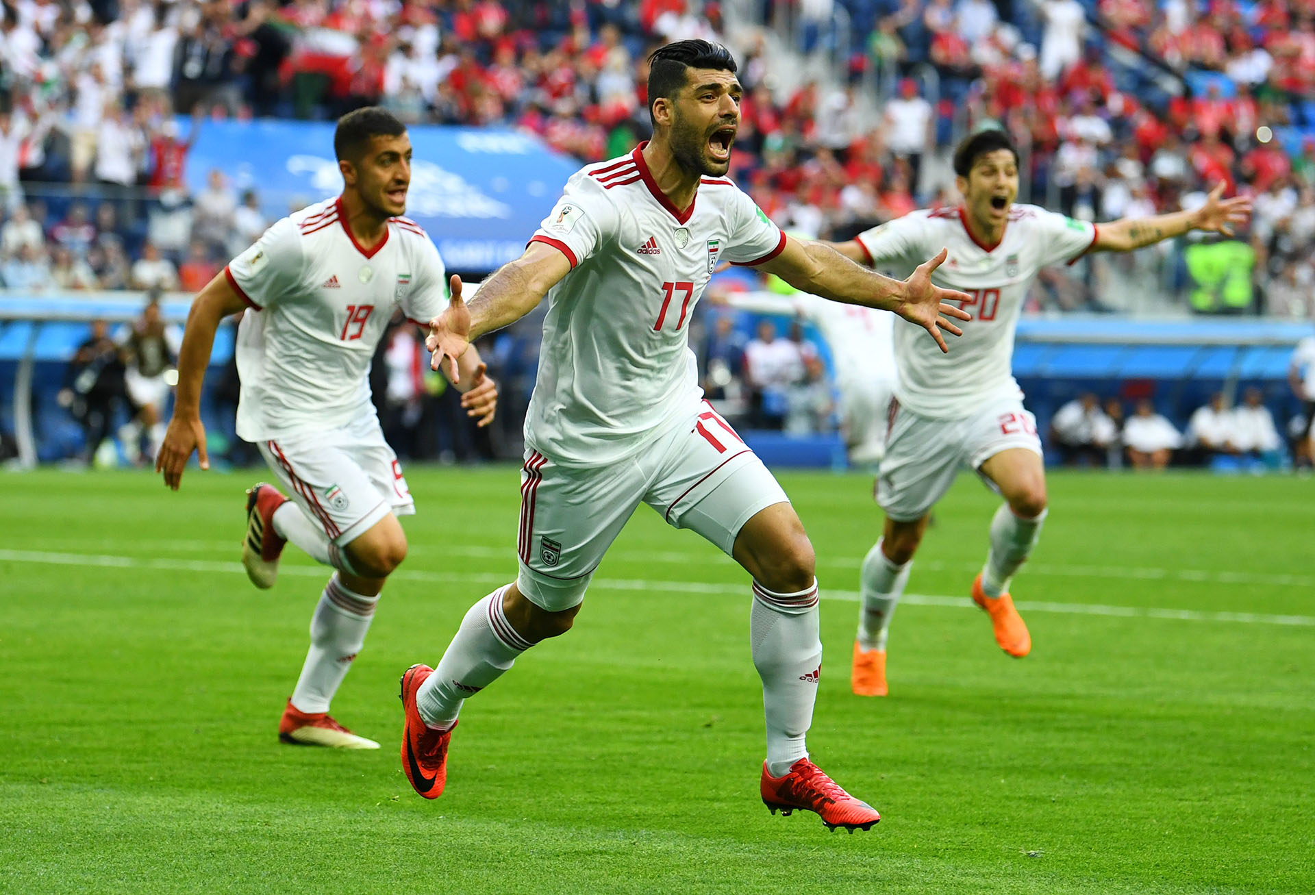 Soccer Football – World Cup – Group B – Morocco vs Iran – Saint Petersburg Stadium, Saint Petersburg, Russia – June 15, 2018 Iran's Mehdi Taremi, Majid Hosseini and Sardar Azmoun celebrate their first goal REUTERS/Dylan Martinez