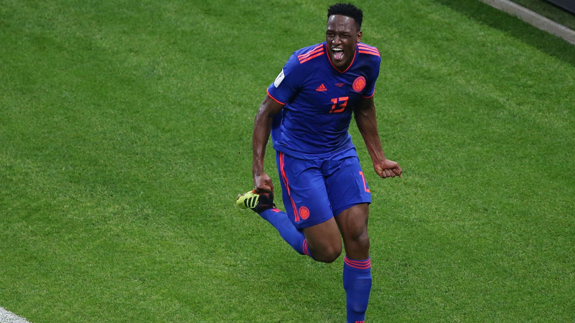 Yerri Mina le ganó el duelo a Robert Lewandowski e hizo el gol del triunfo de Colombia (AFP)