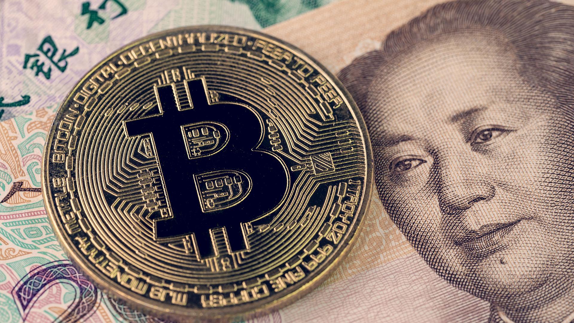 Las regulaciones a los criptoactivos impuestas por el gobierno chino desmotivó la compra de bitcoin mediante la moneda local (Getty Images)