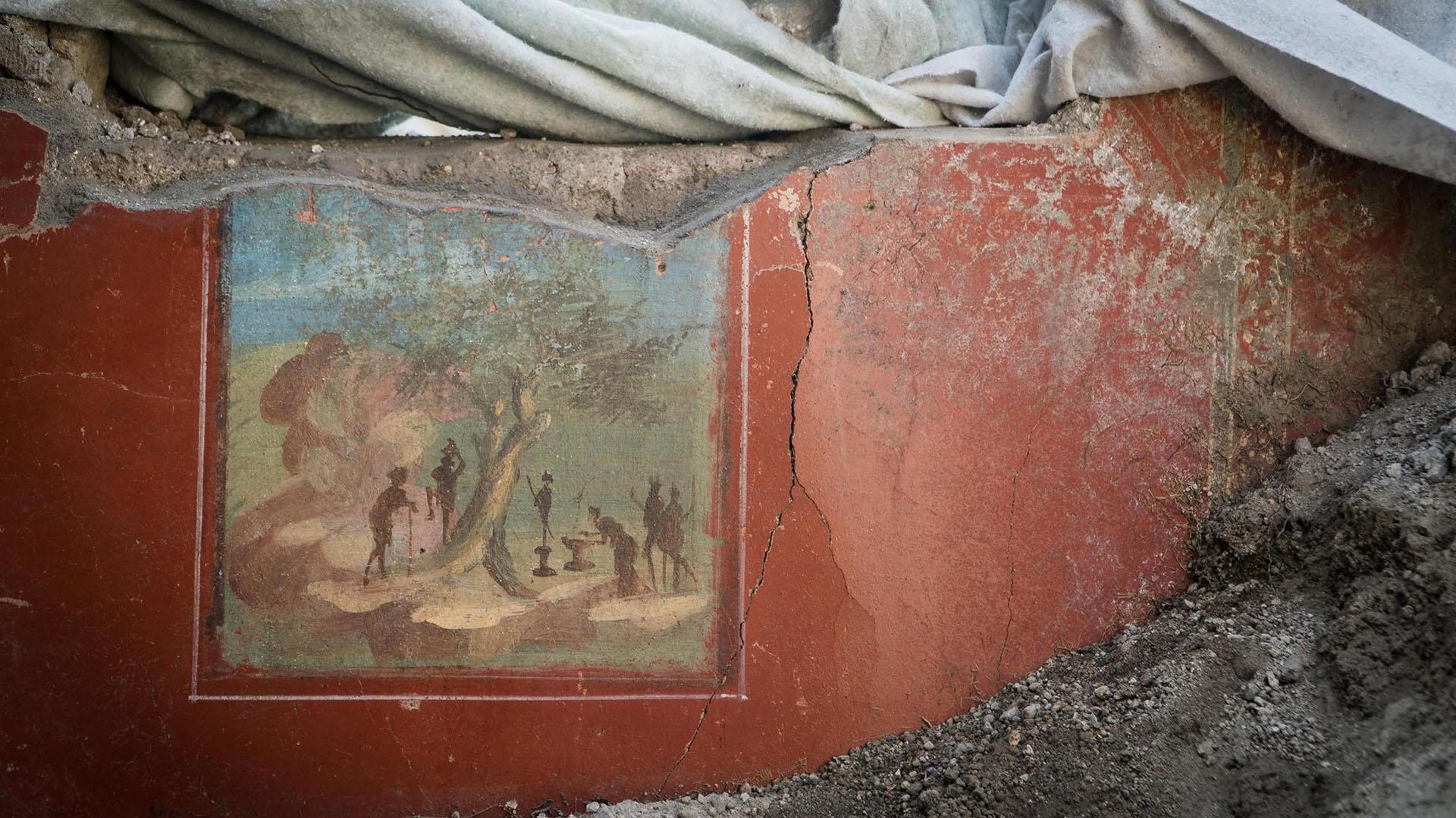 Un muro con frescos en la Casa de Júpiter (Casa di Giove), de la que también se recuperaron objetos y utensilios propios de la vida diaria(EFE/ Cesare Abbate)