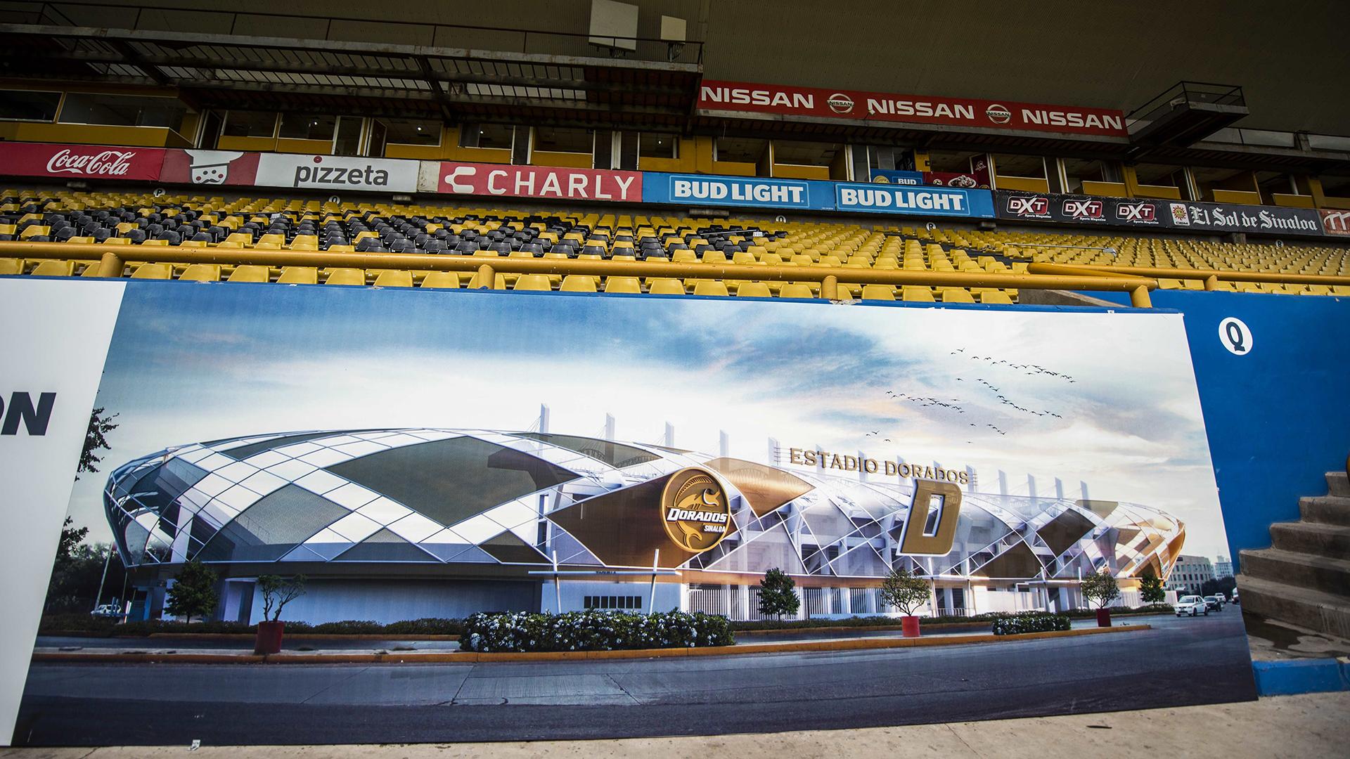 Una imagen del proyecto de remodelación del estadio de los Dorados está representada junto a las tribunas delrecinto Banorte, del club mexicano de segunda división Dorados. La expectativa es que el fenómeno Maradona multiplique la ganancia del club, que ya agotó las camisetas con el nombre de su nuevo DT con el número 10 en su dorsal(AFP)