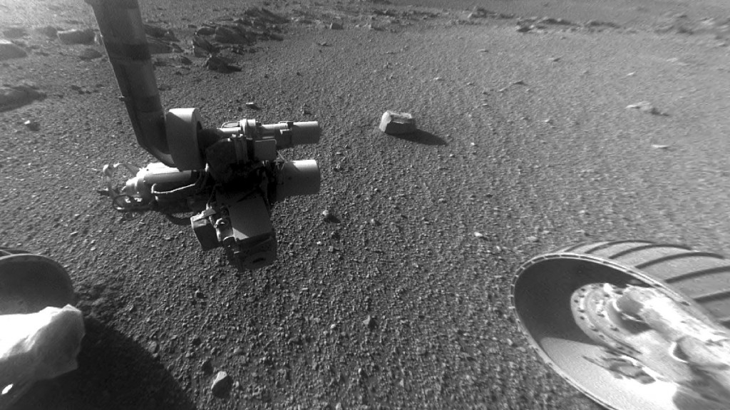 This Jan. 4, 2018 photo made available by NASA shows a view from the front Hazard Avoidance Camera of the Opportunity rover on the inboard slope of the western rim of Endeavour Crater on the planet Mars. A global dust storm prevented sunlight from reaching Opportunity's solar panels, and the rover fell silent in June 2018. Although the skies have cleared considerably, Opportunity has yet to send word to flight controllers as of Tuesday, Sept. 25, 2018. (NASA/JPL-Caltech via AP)