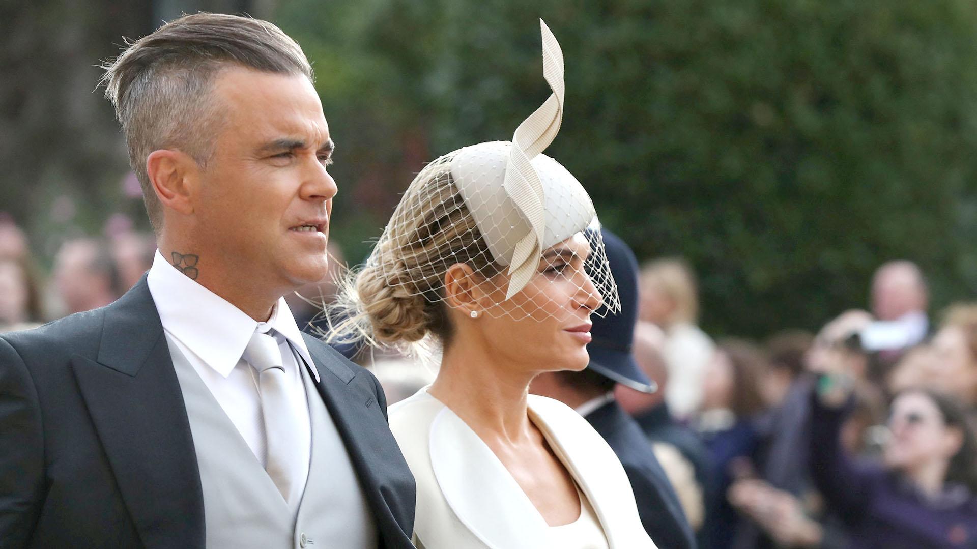 Robbie Williams y Ayda Field, de los primeros invitados a llegar a la boda real