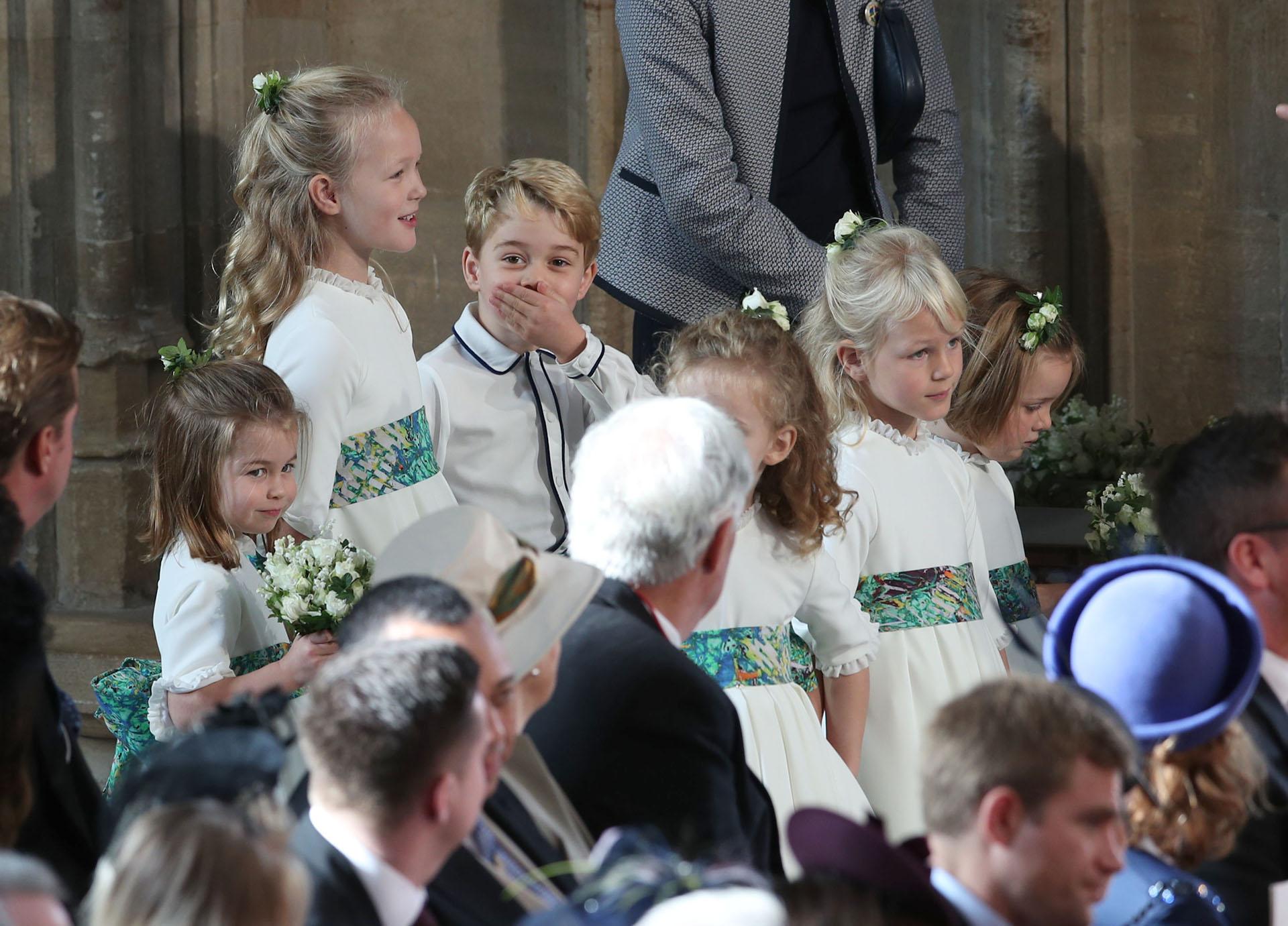 El príncipe George risueño y divertido durante la ceremonia